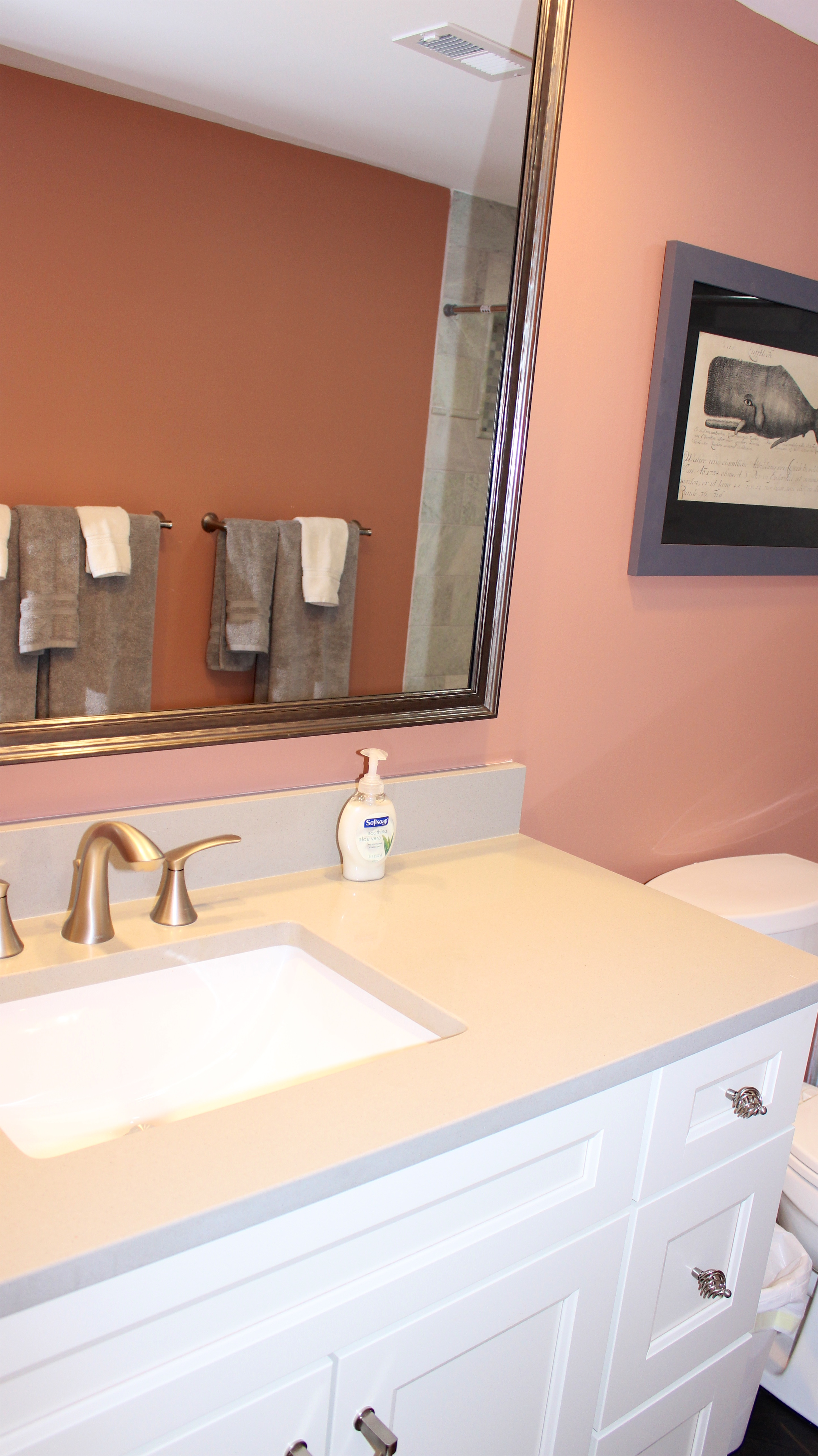 The master bath has a large vanity topped with granite.