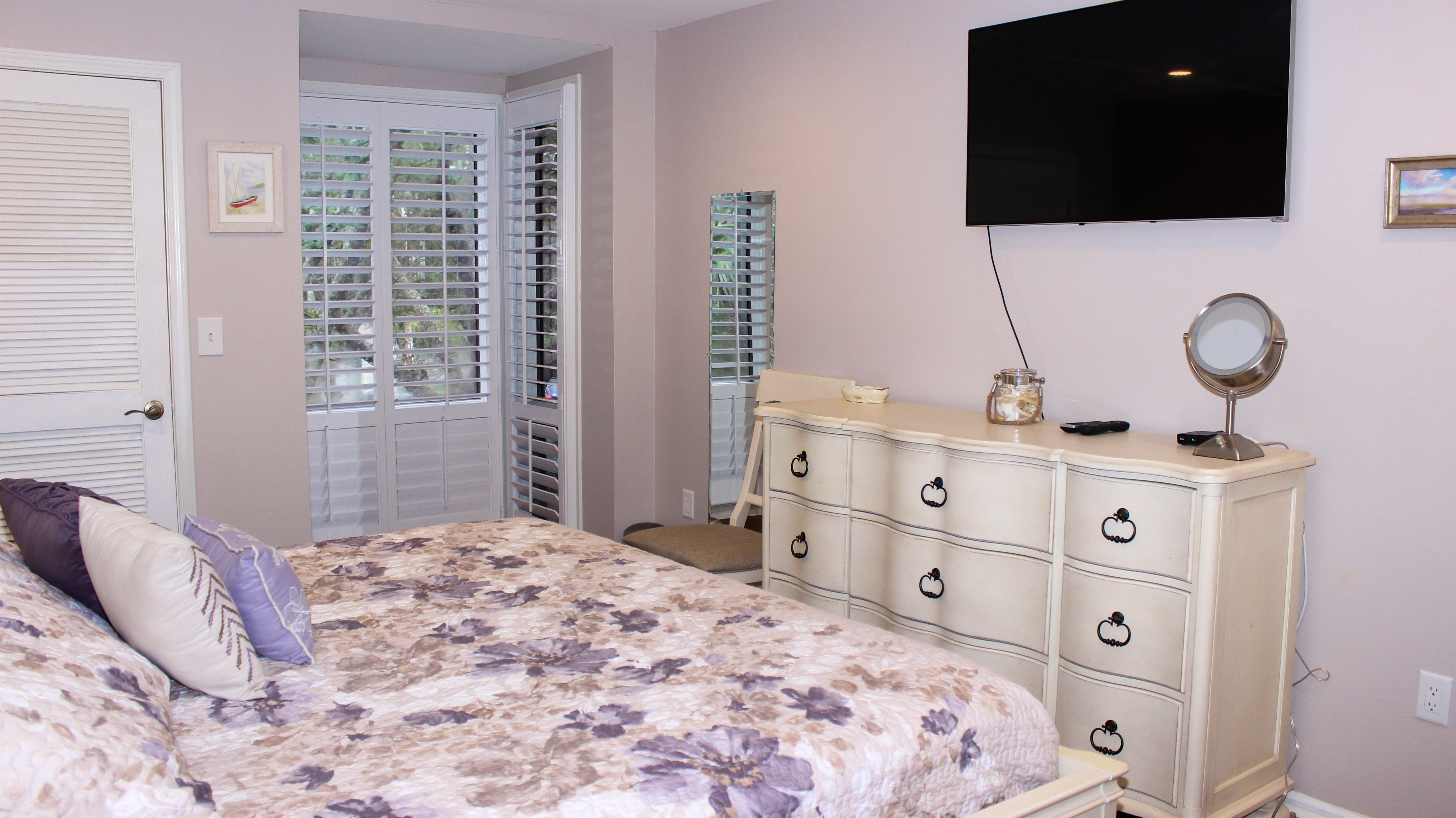 This retreat has a wall mounted HDTV, plantation shutters and new dresser.
