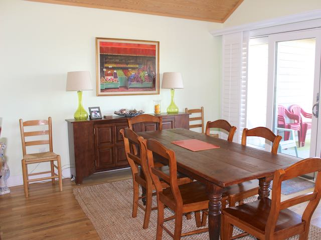 The dining room has a large table that seats eight.