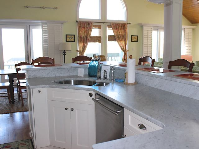 The kitchen has a marble topped island and is open to the great room.
