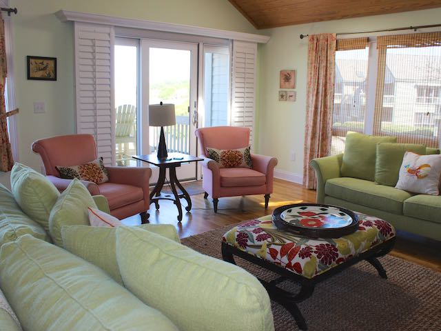 The living room offers panoramic views of the ocean and Edisto River.