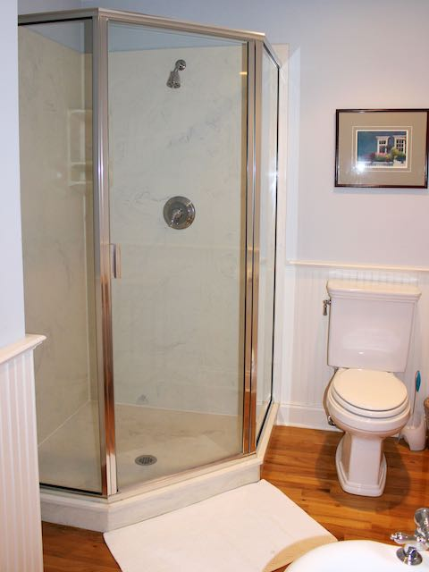 Rinse in the large shower with glass doors.