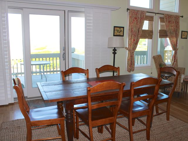Sliding doors allow sunlight and fabulous views of the Edisto River.