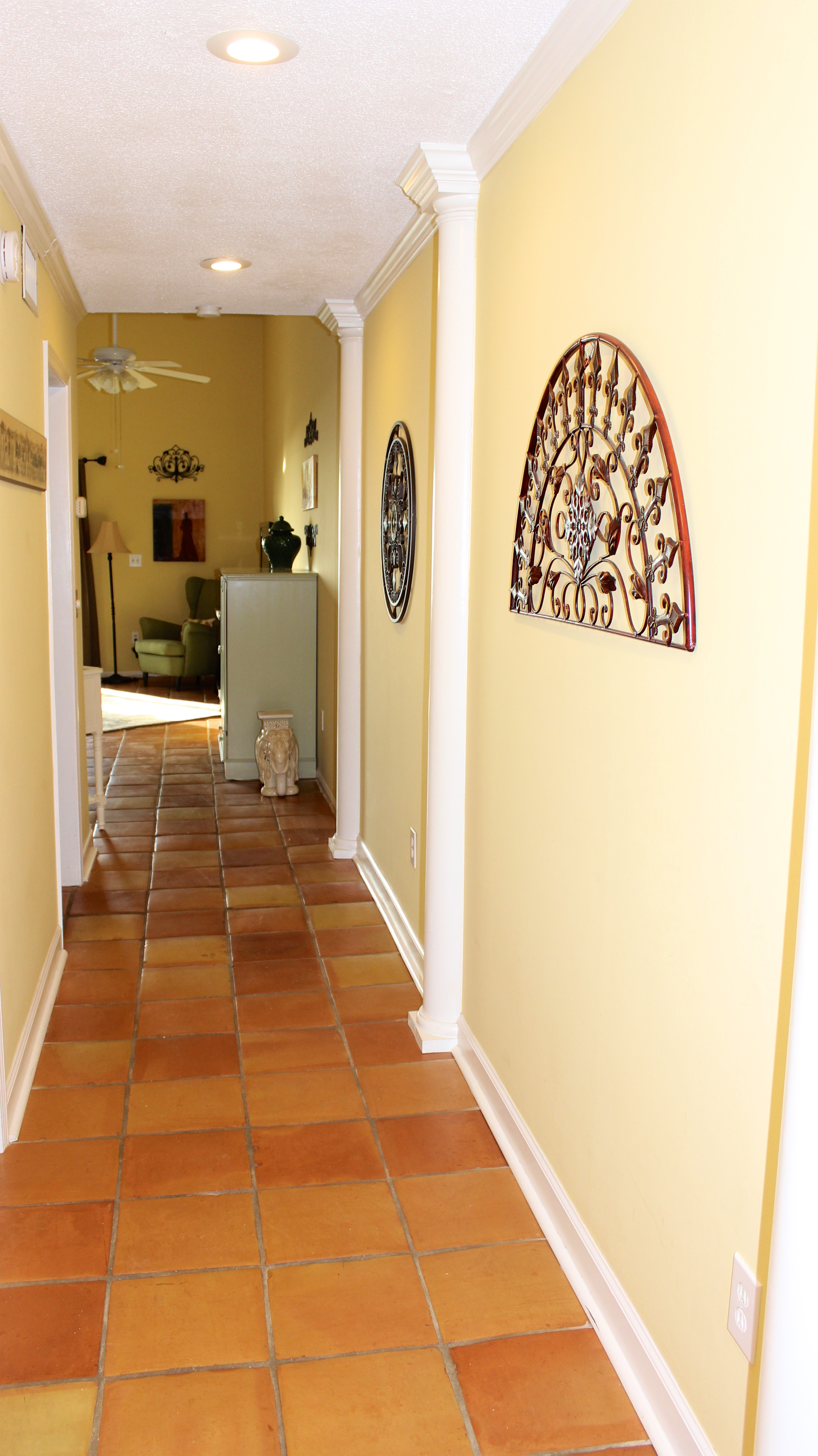 Features include accent pillars, iron artwork and whimsical decorating touches.