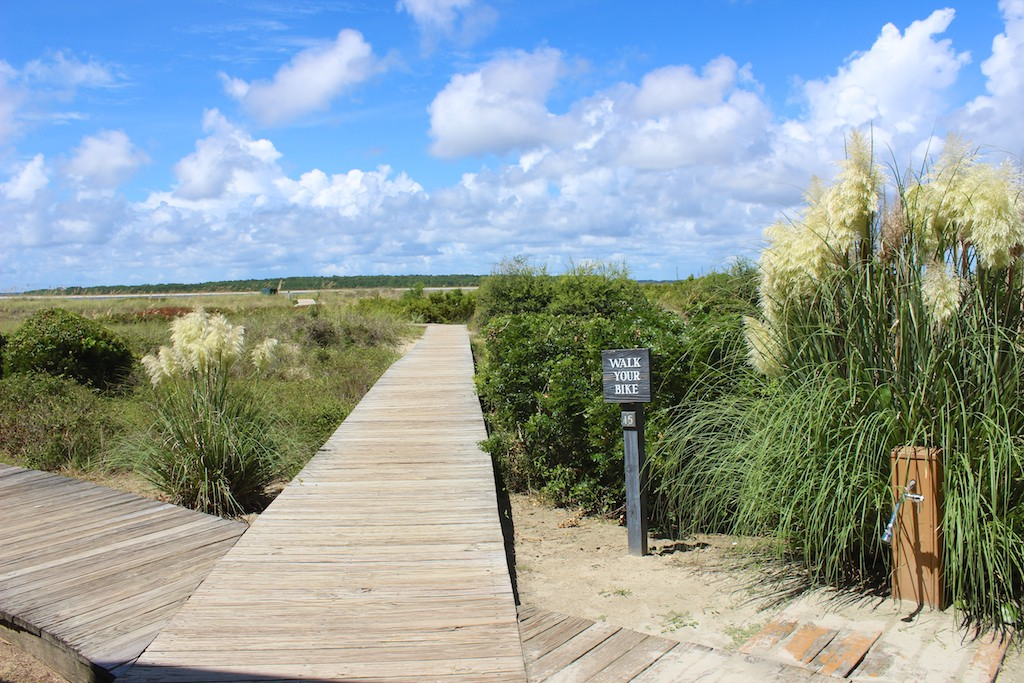 Walk off the back deck to the boardwalk to Pelican Beach.