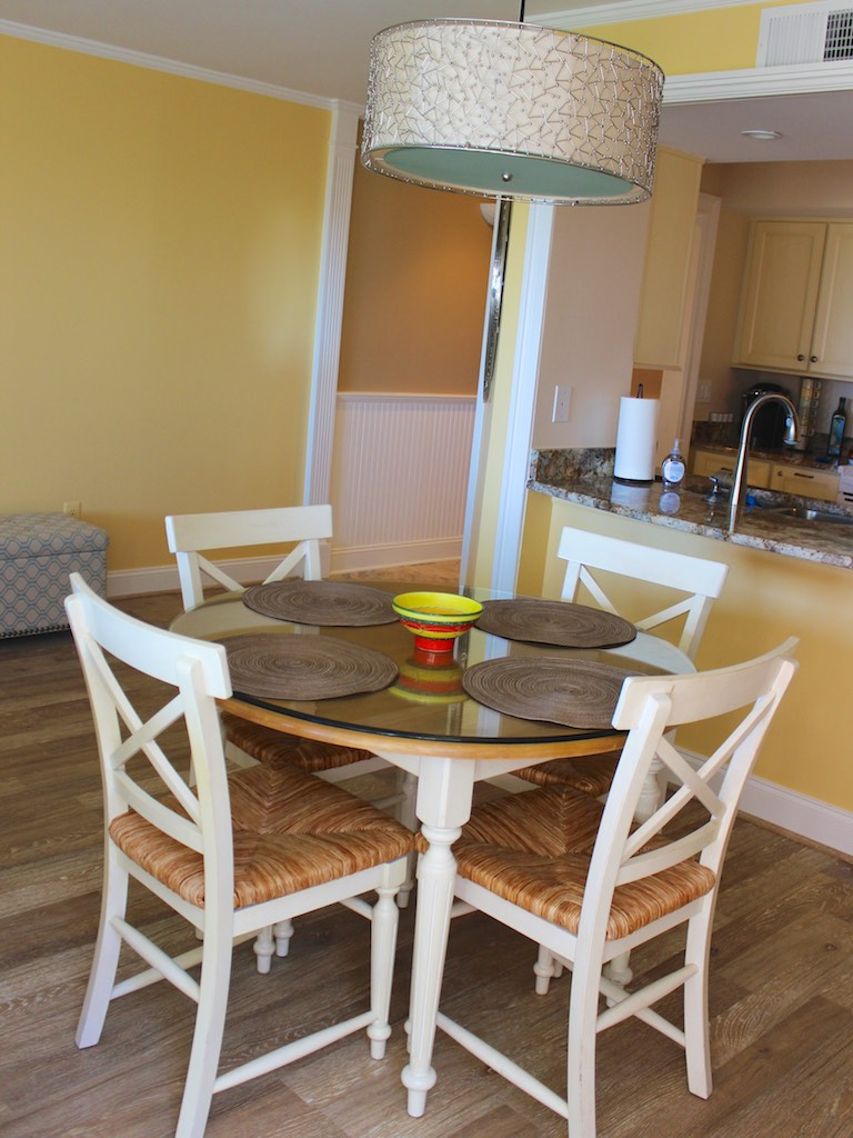 The dining area opens into the gorgeous kitchen.