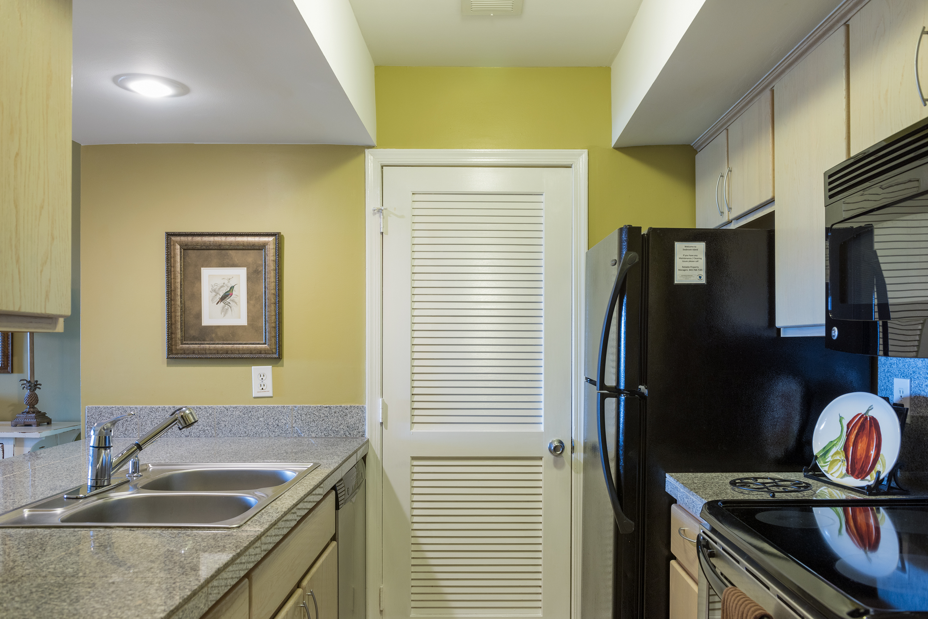 The well equipped kitchen has been remodeled! There is a stack washer and dryer in the closet.