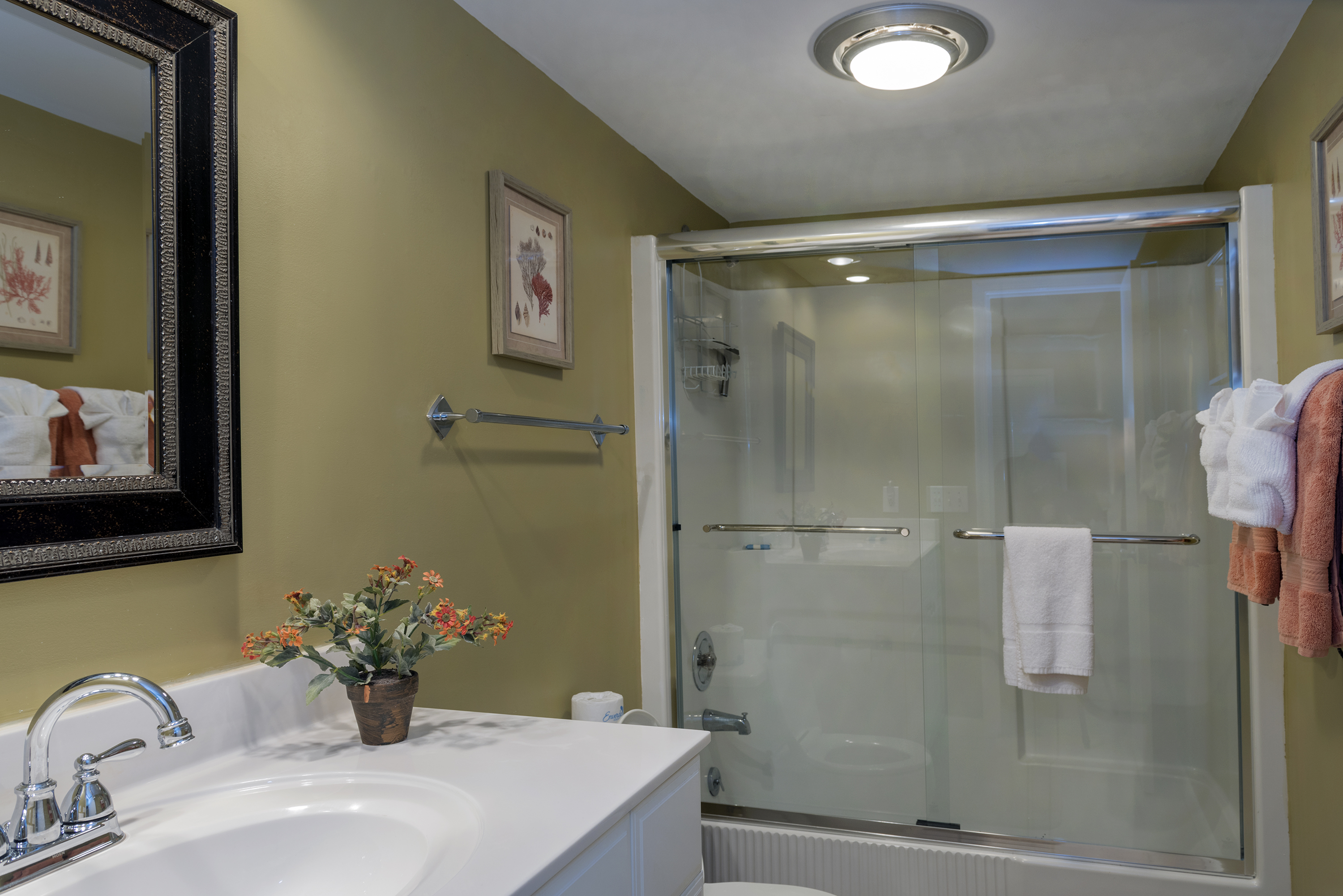 It has a shower/tub with new glass doors.