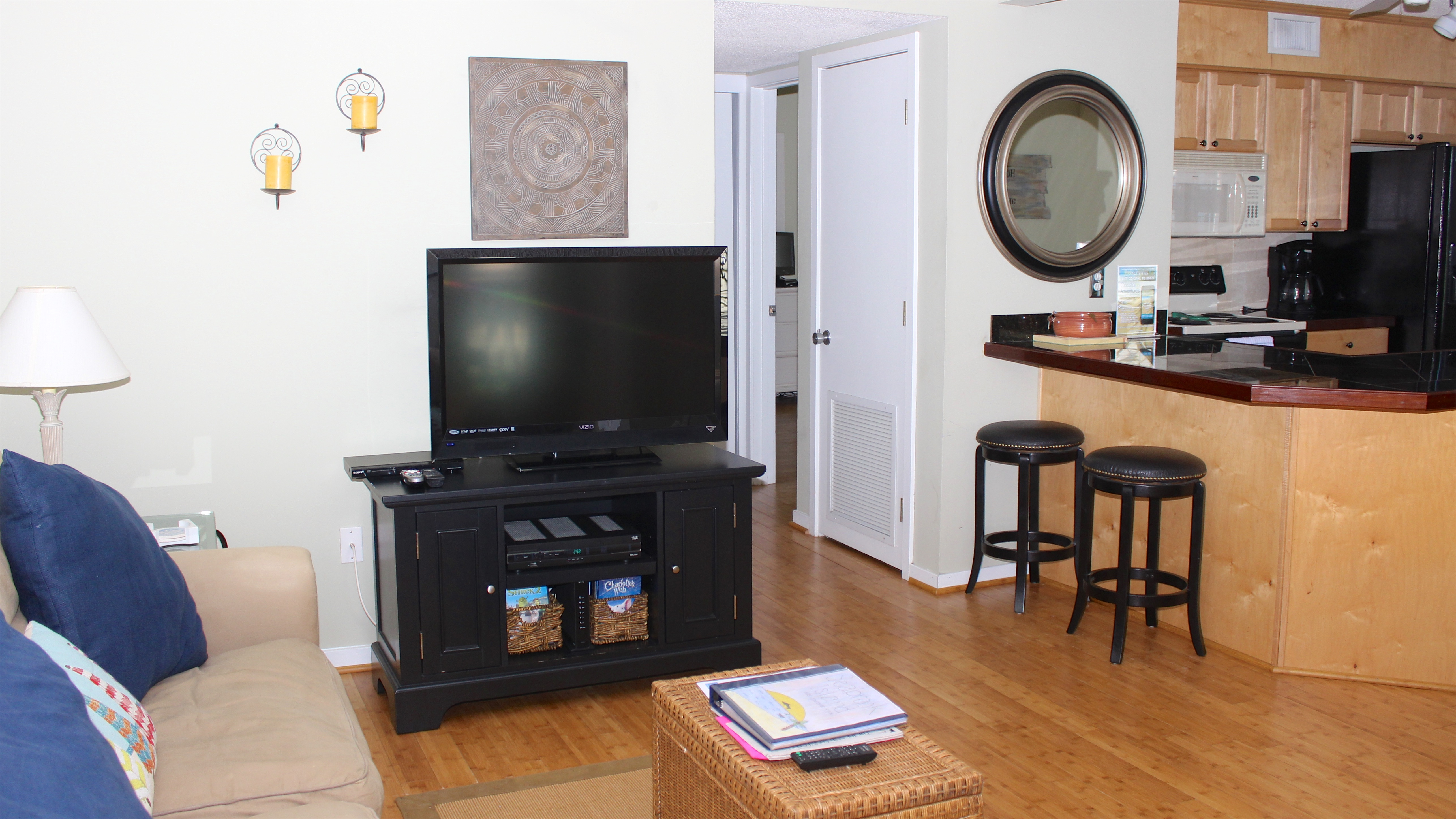 It features hardwood floors and a large HDTV/DVD.