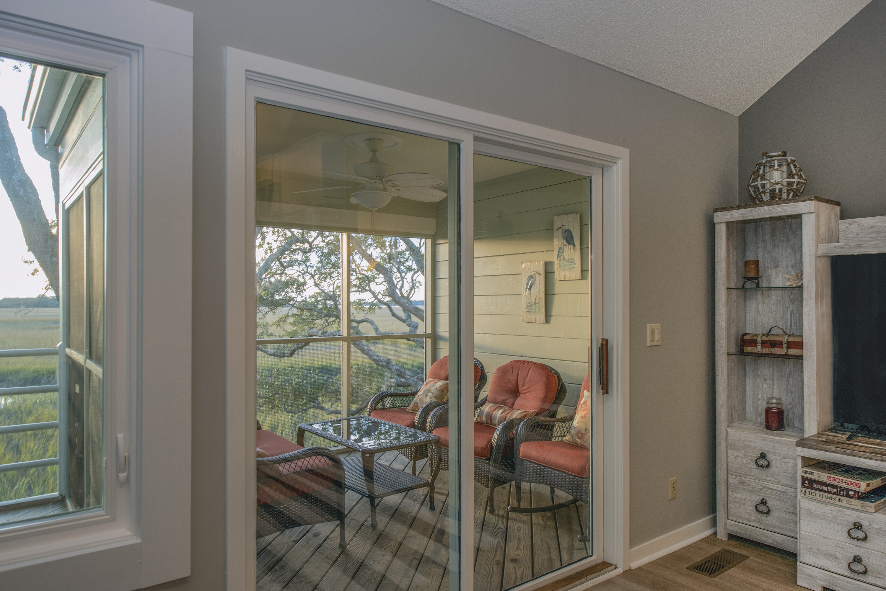 Sliding doors lead to the outside porch.