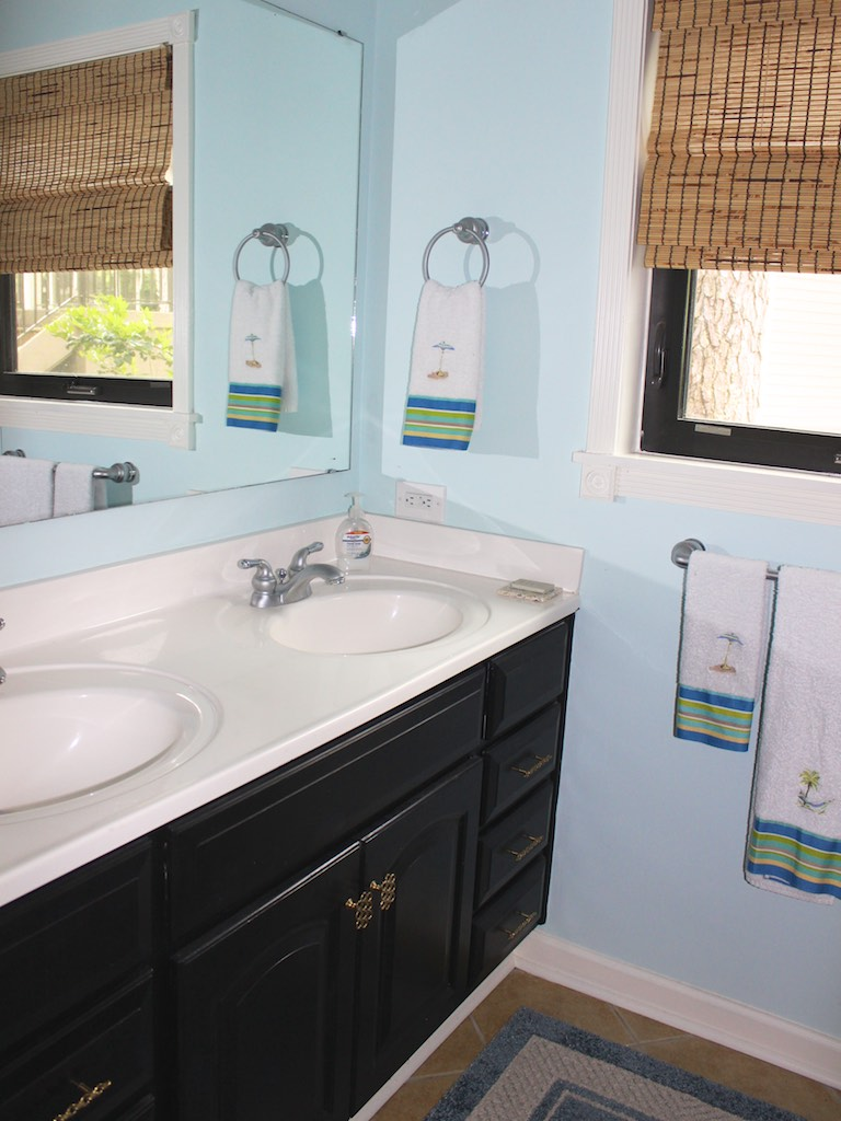The large bathroom has a double sink.