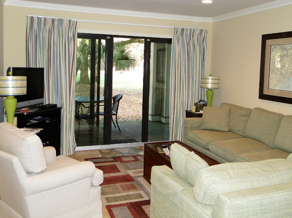 The living room has a comfy sectional sofa and HDTV/DVD player.