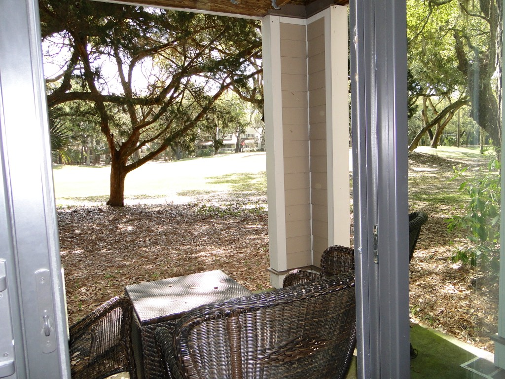 Step to the covered porch through the sliding doors.