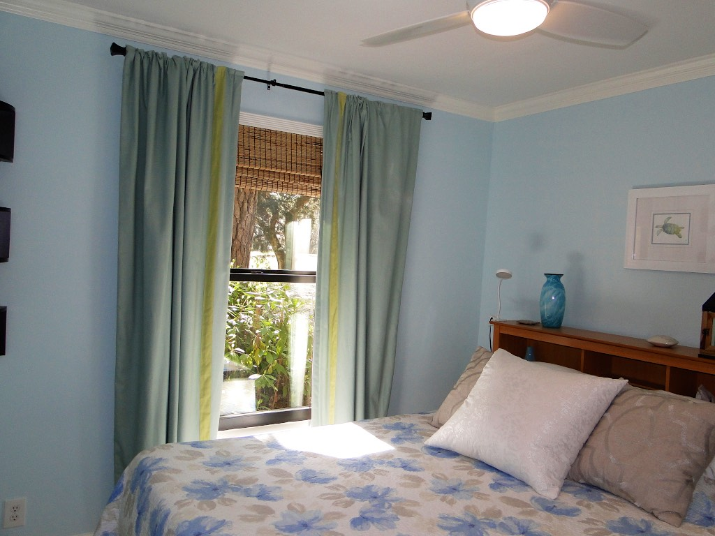 The windows allows sunlight and shaded views.