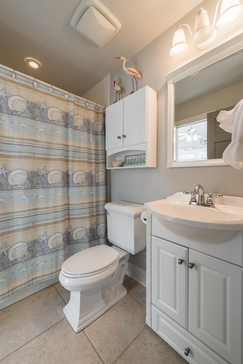 The first floor bathroom has tile flooring and a tub/shower combination.