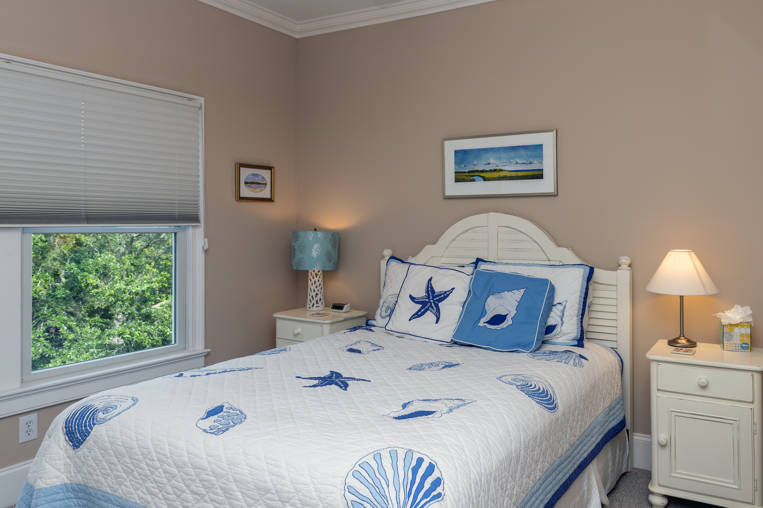 A second bedroom upstairs has a queen bed.