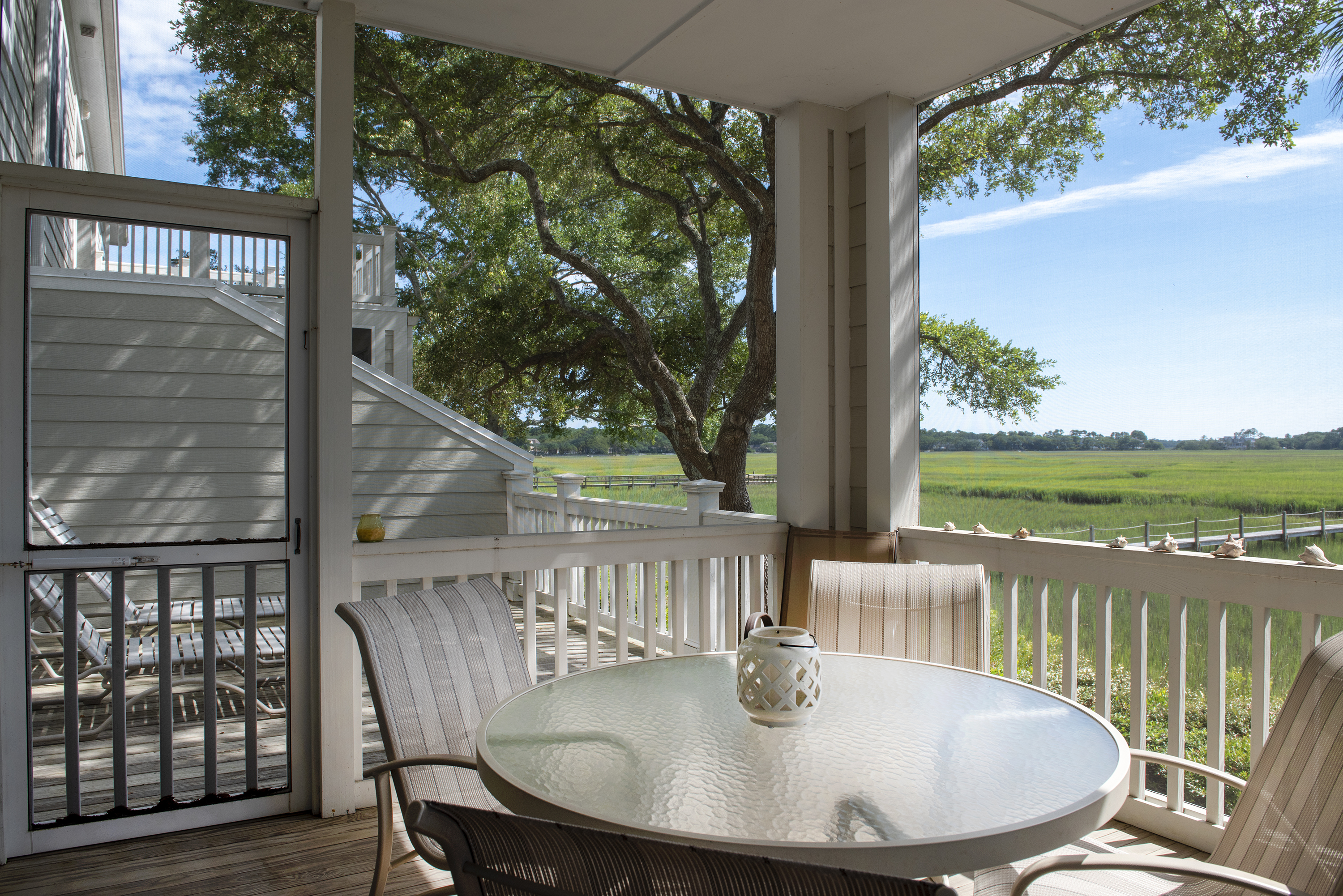 The creened porch has a dining table for 4.