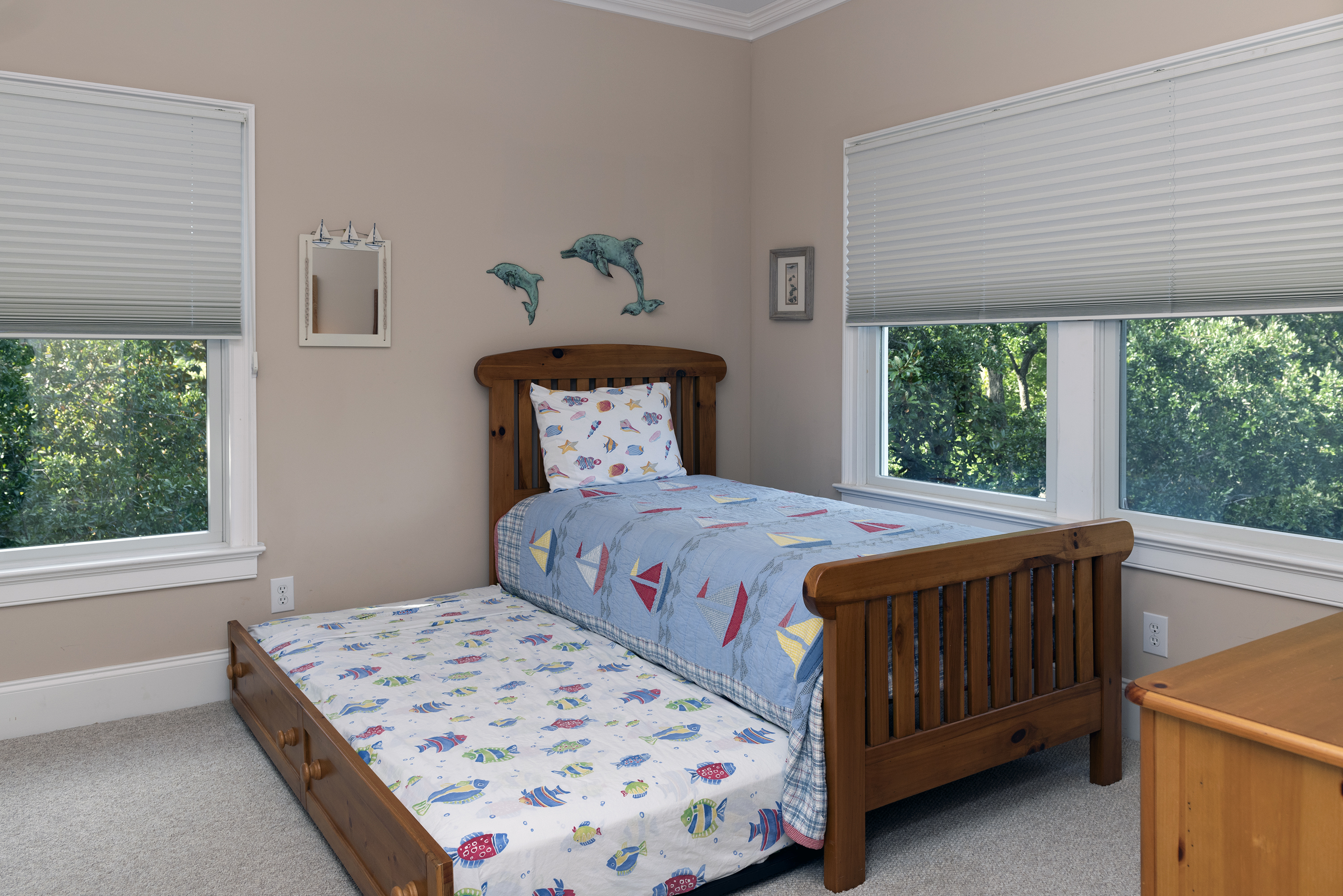 The third guest bedroom has a twin bed with trundle.