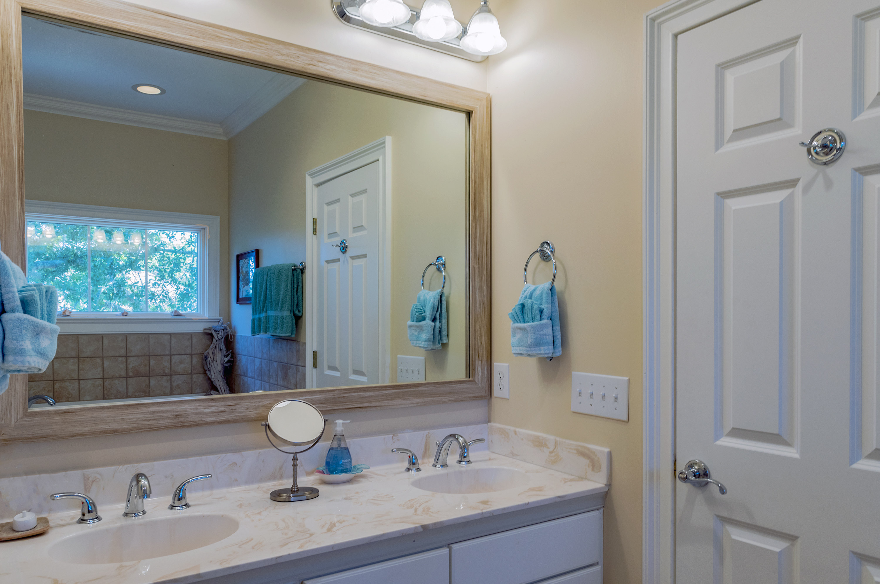 The master bath has dual sinks and tile flooring.