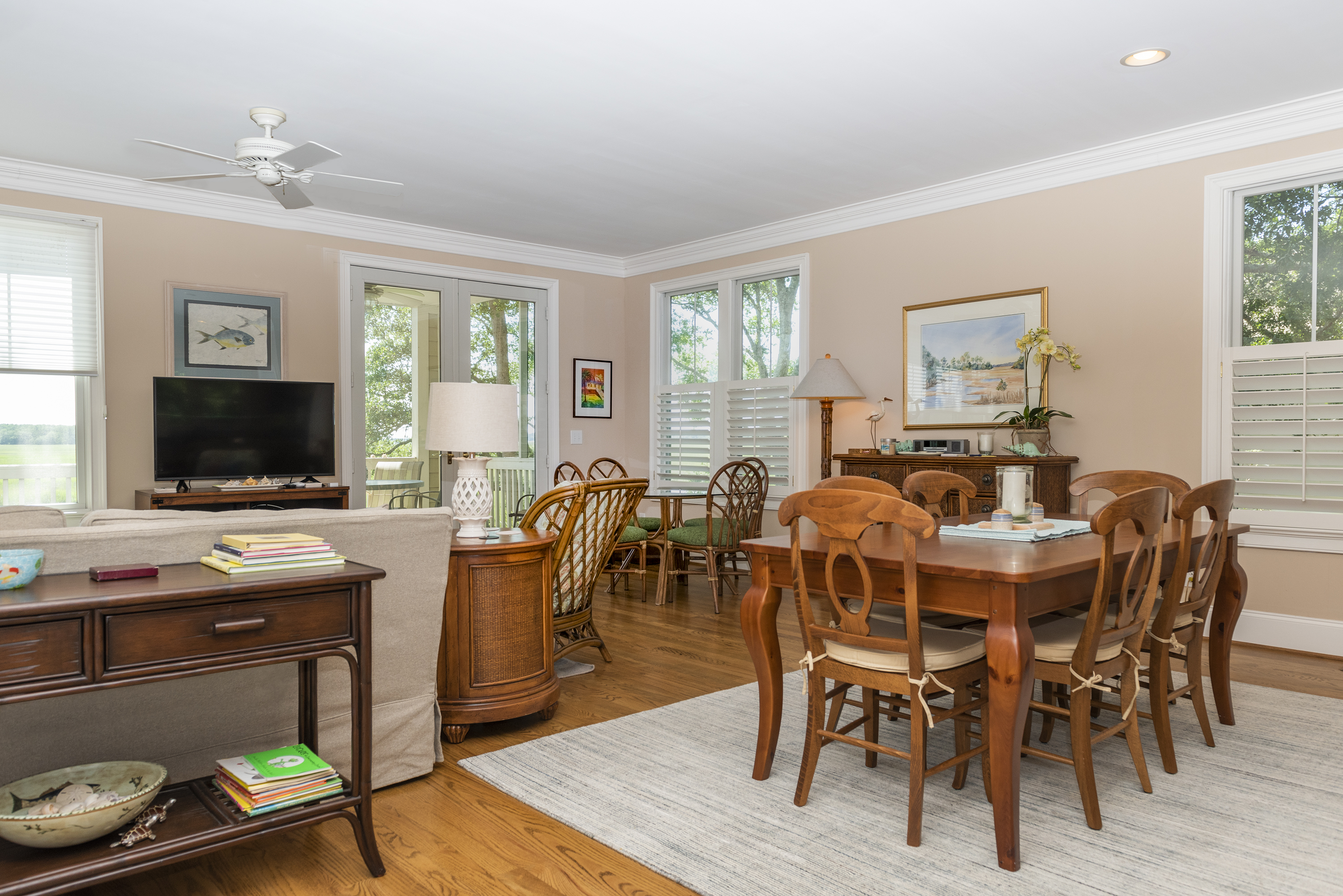 Multiple dining options and french doors leading to the screened porch.