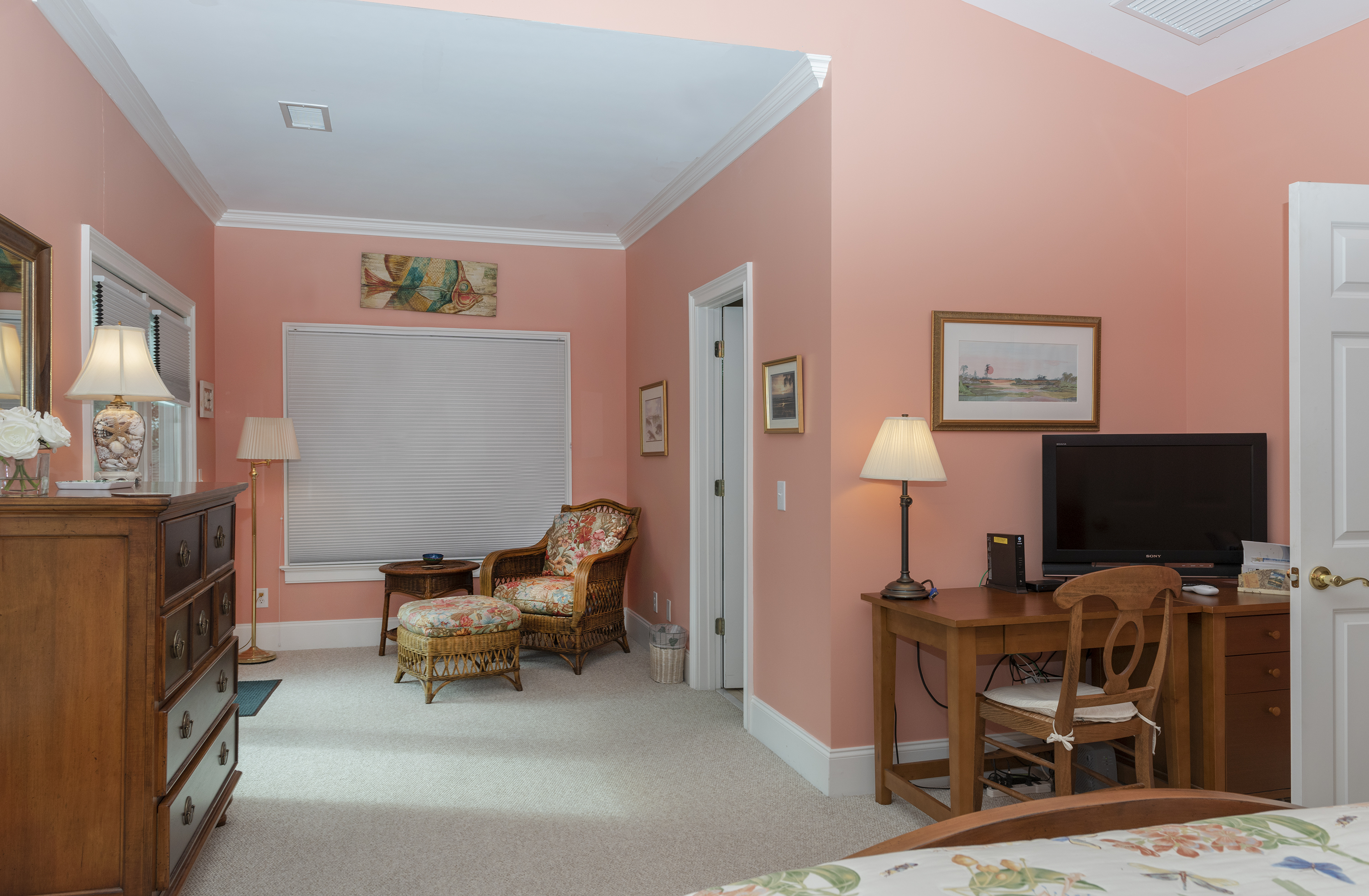 A writing desk, 36' TV, reading nook and private porch make this a fabulous master suite!
