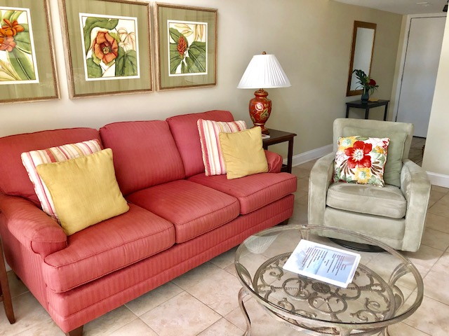 Colorful living area with queen sofa sleeper.