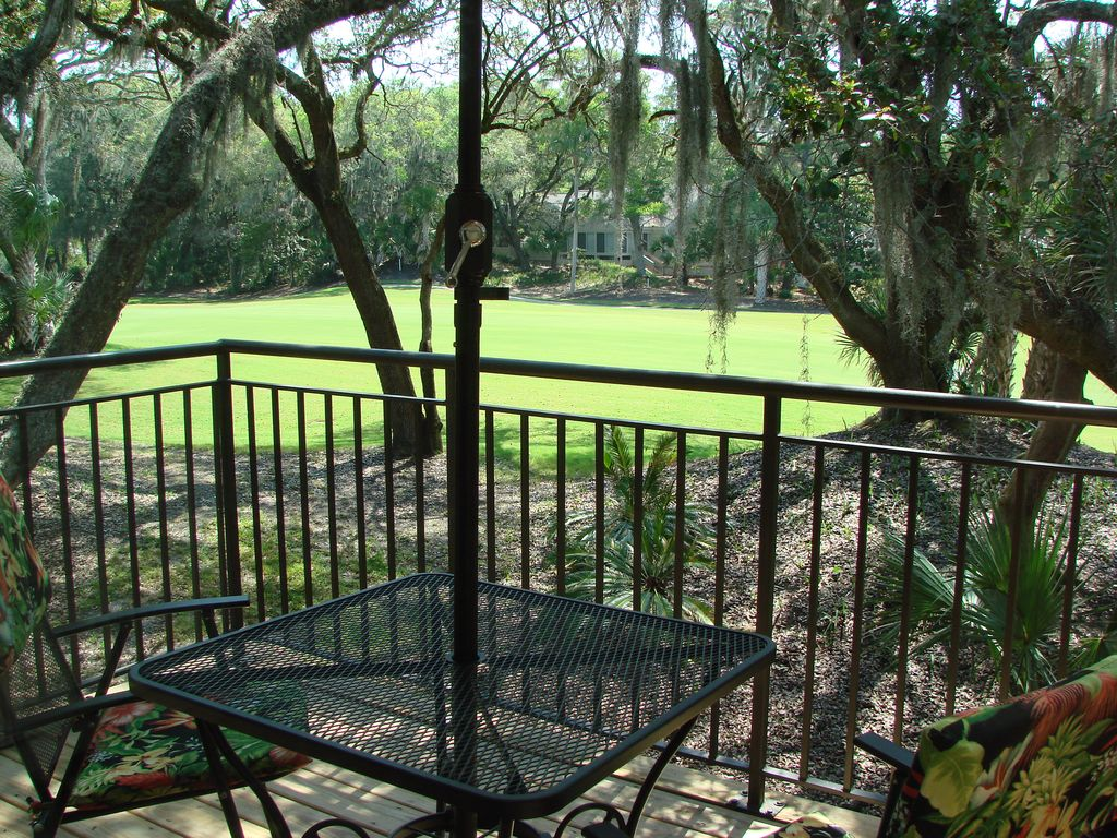 Deck seating/dining overlooking the fairway.