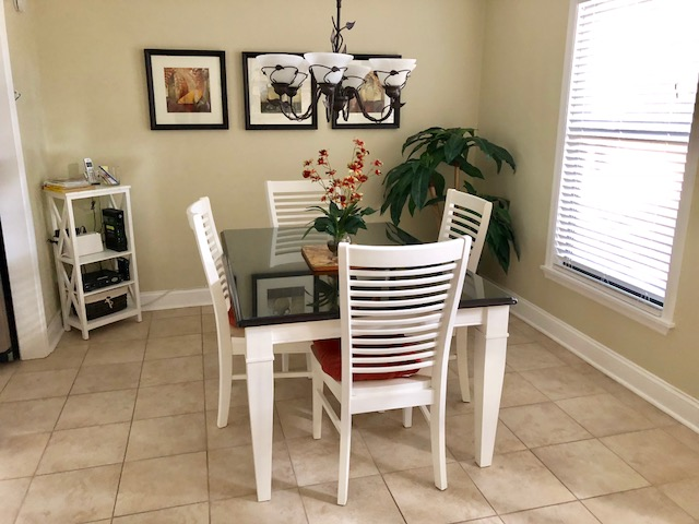 Enjoy a meal together in this casual seating for four.