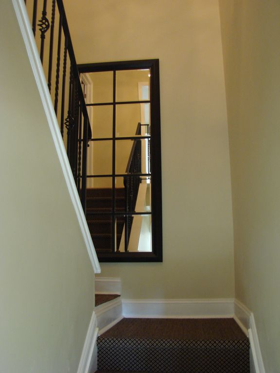 An open stairway leads to the bedroom and full bath.