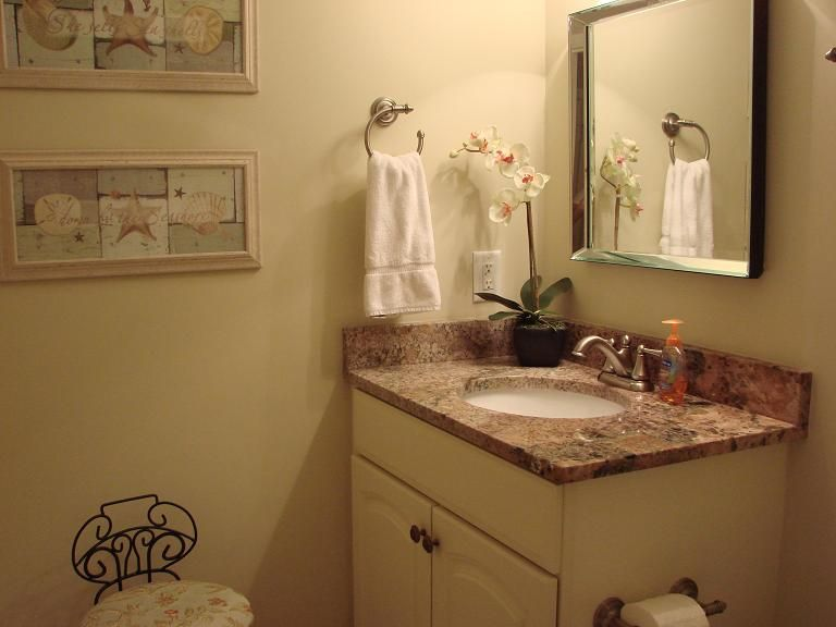 Powder room conveniently located near living room and front entry.
