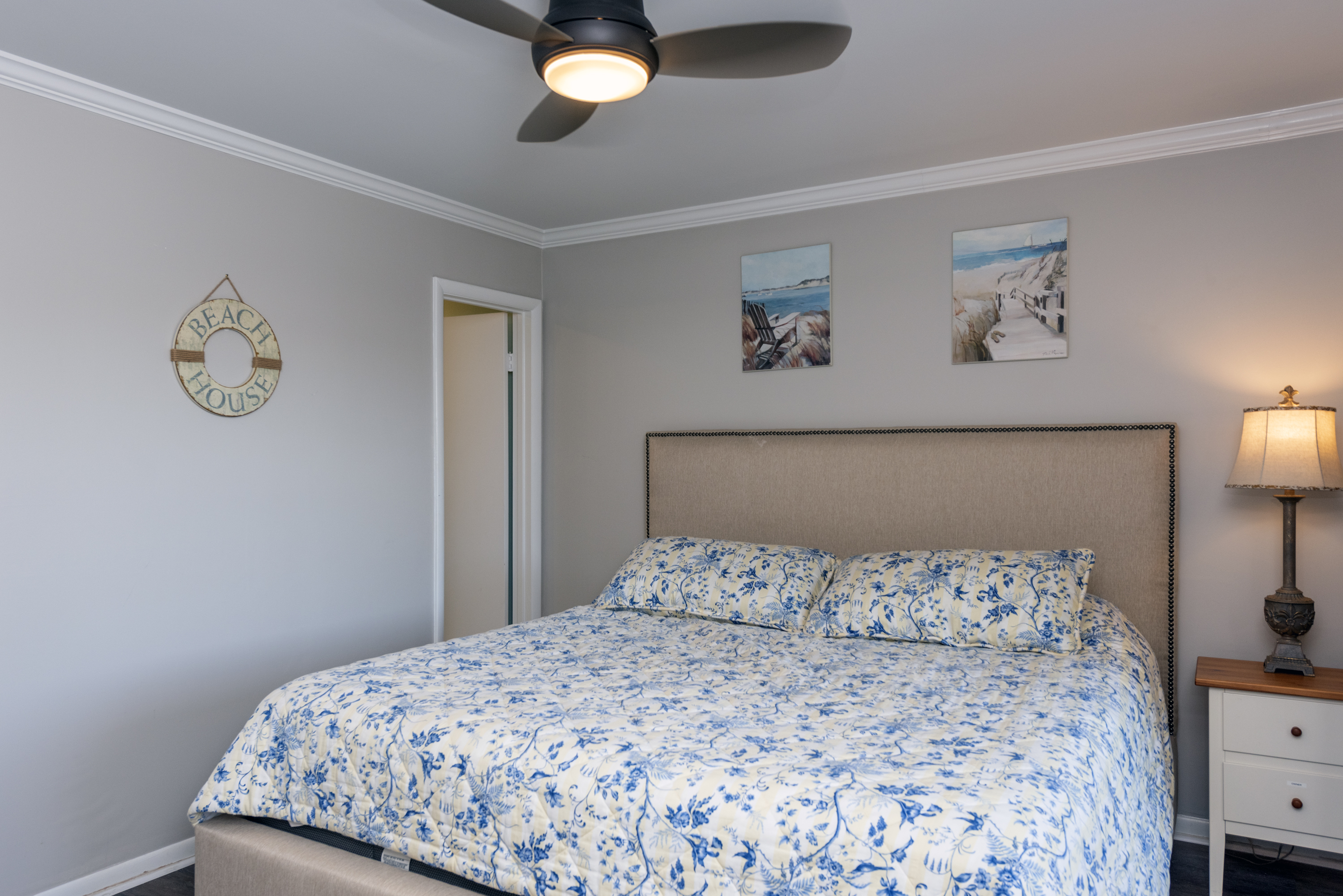 The master features a king size bed and en suite bathroom. Sliding glass doors lead to the screened in porch.