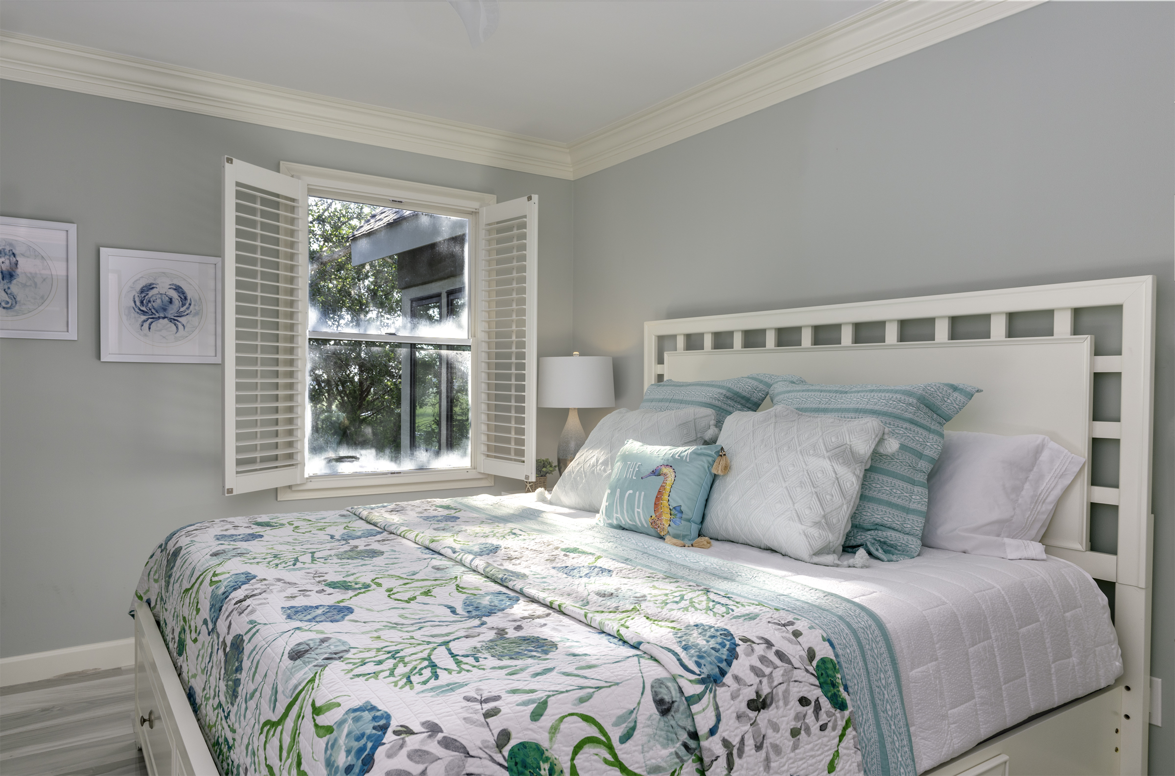 Bright and airy guest bedroom with king bed.