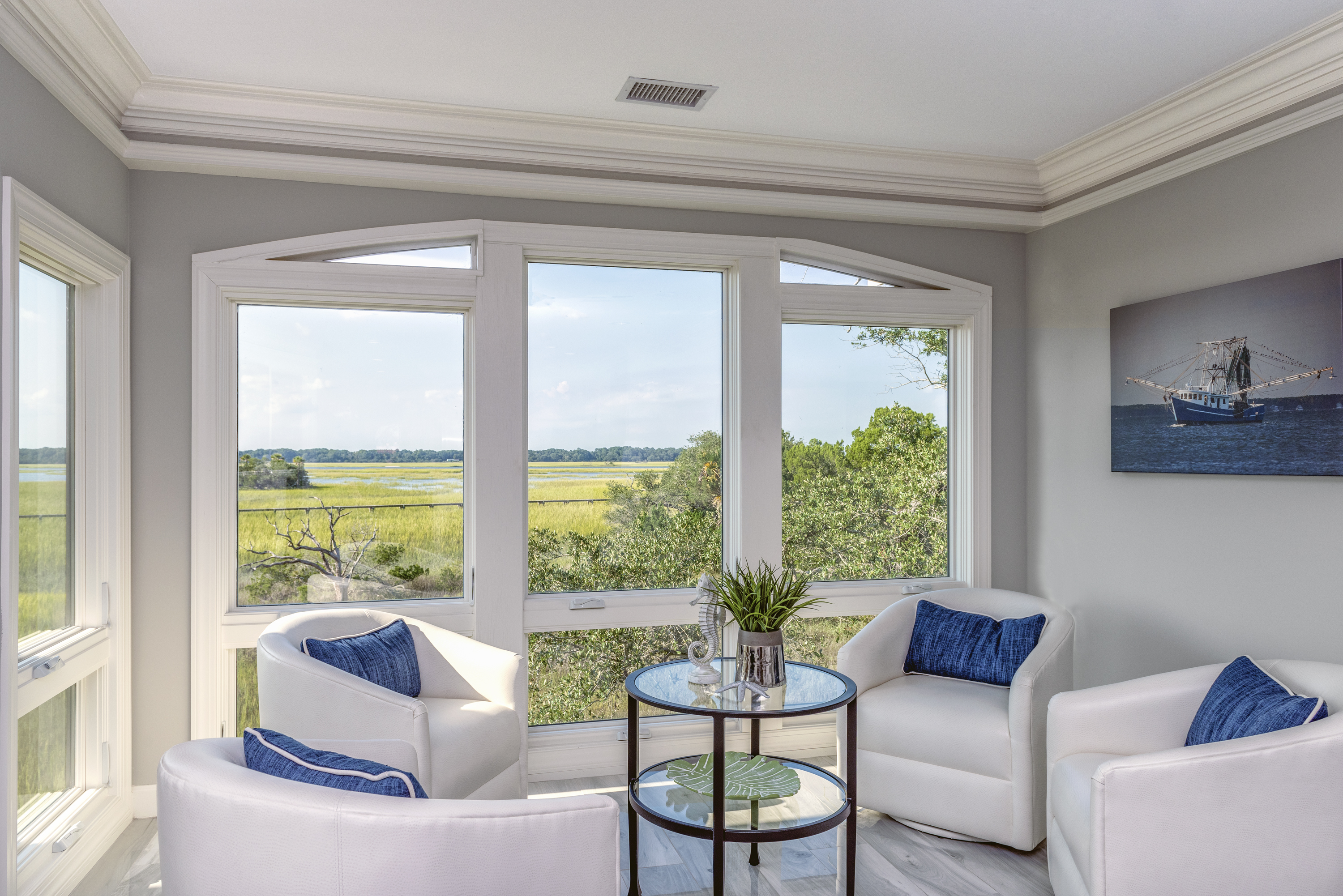 Comfortable sitting area with amazing views of marsh, boats and sunsets.