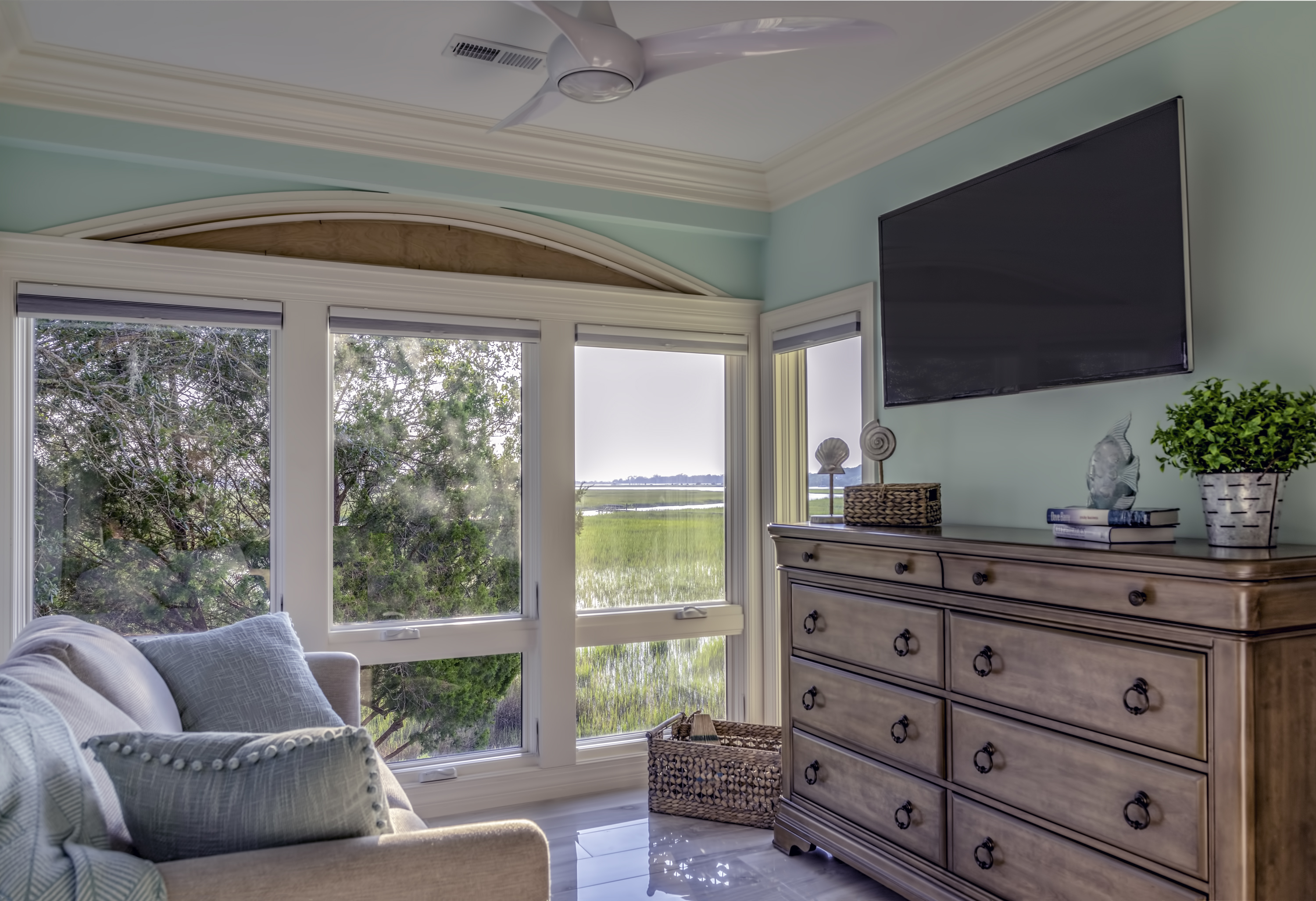 Master bedroom with comfortable sitting area with Marsh Views and large HDTV.