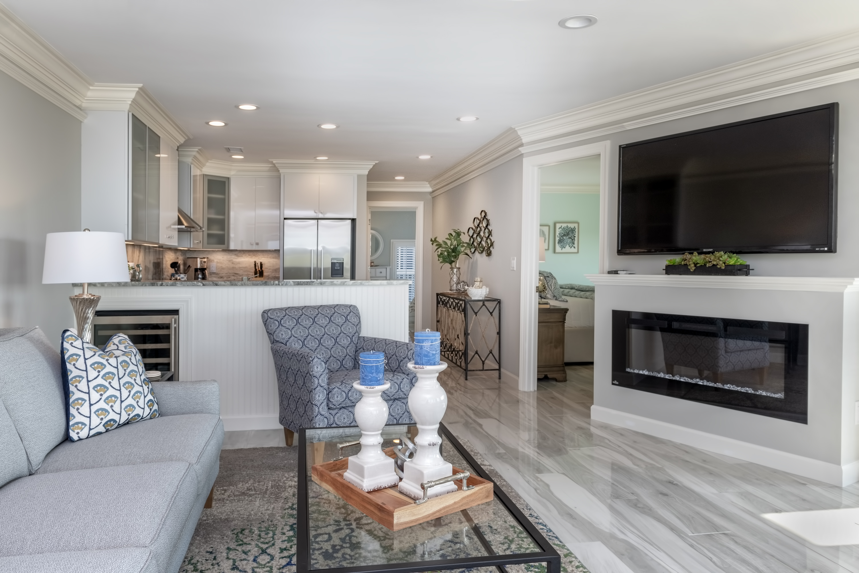 """Spacious open living area with 65"""" HDTV and fireplace."""