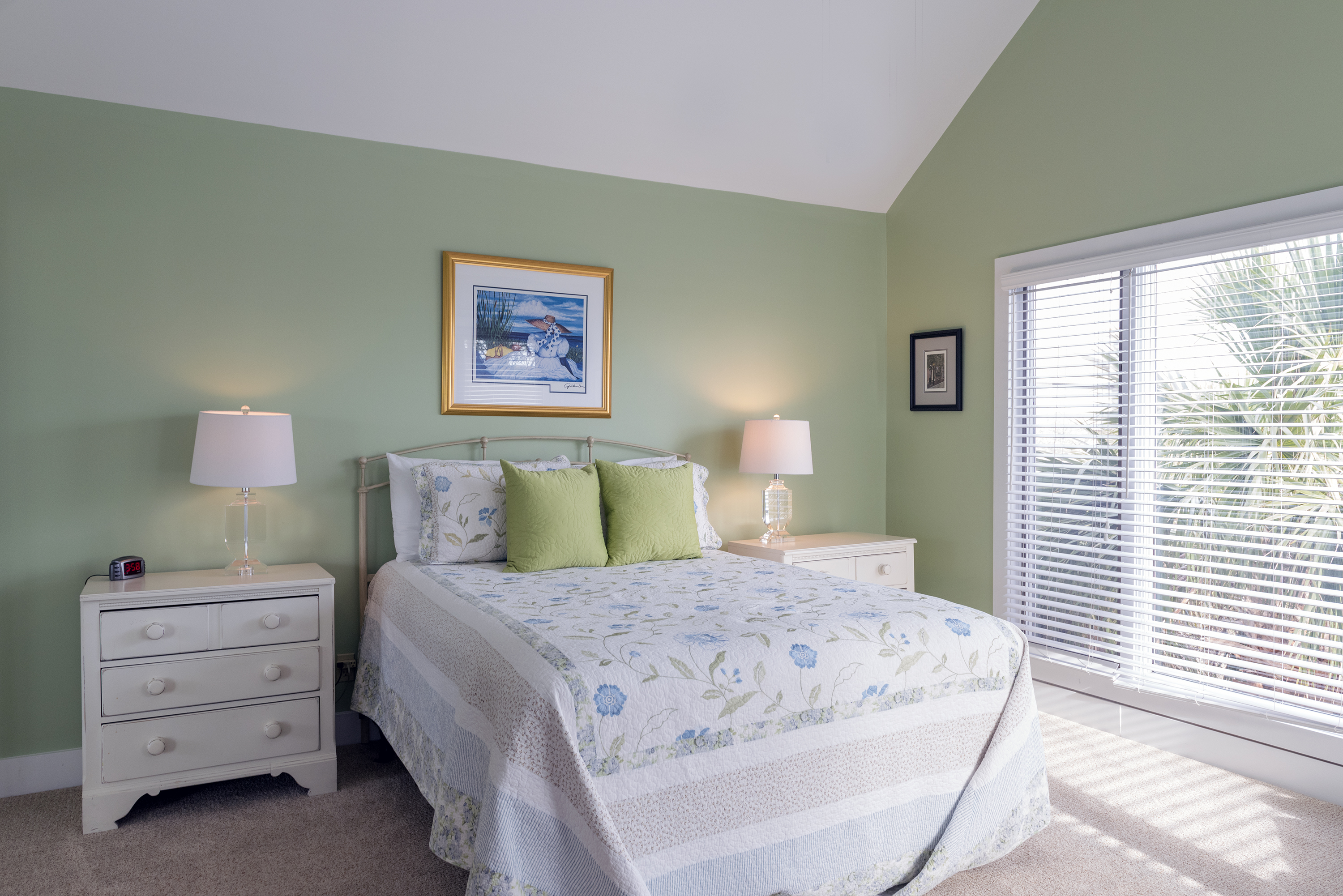 The 2nd floor master bedroom has a queen bed and is located off the main living area.