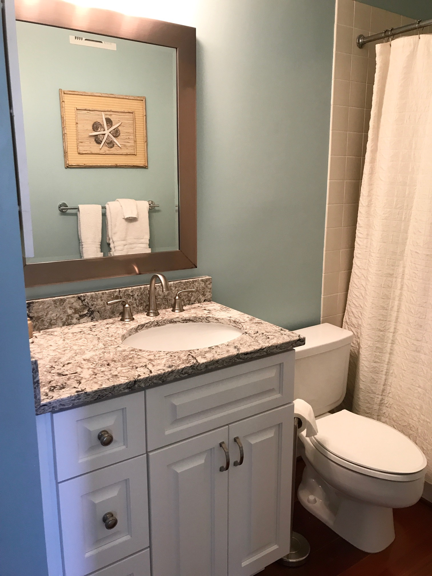 The third bathroom opens to the downstairs hallway and the 3rd bedroom.