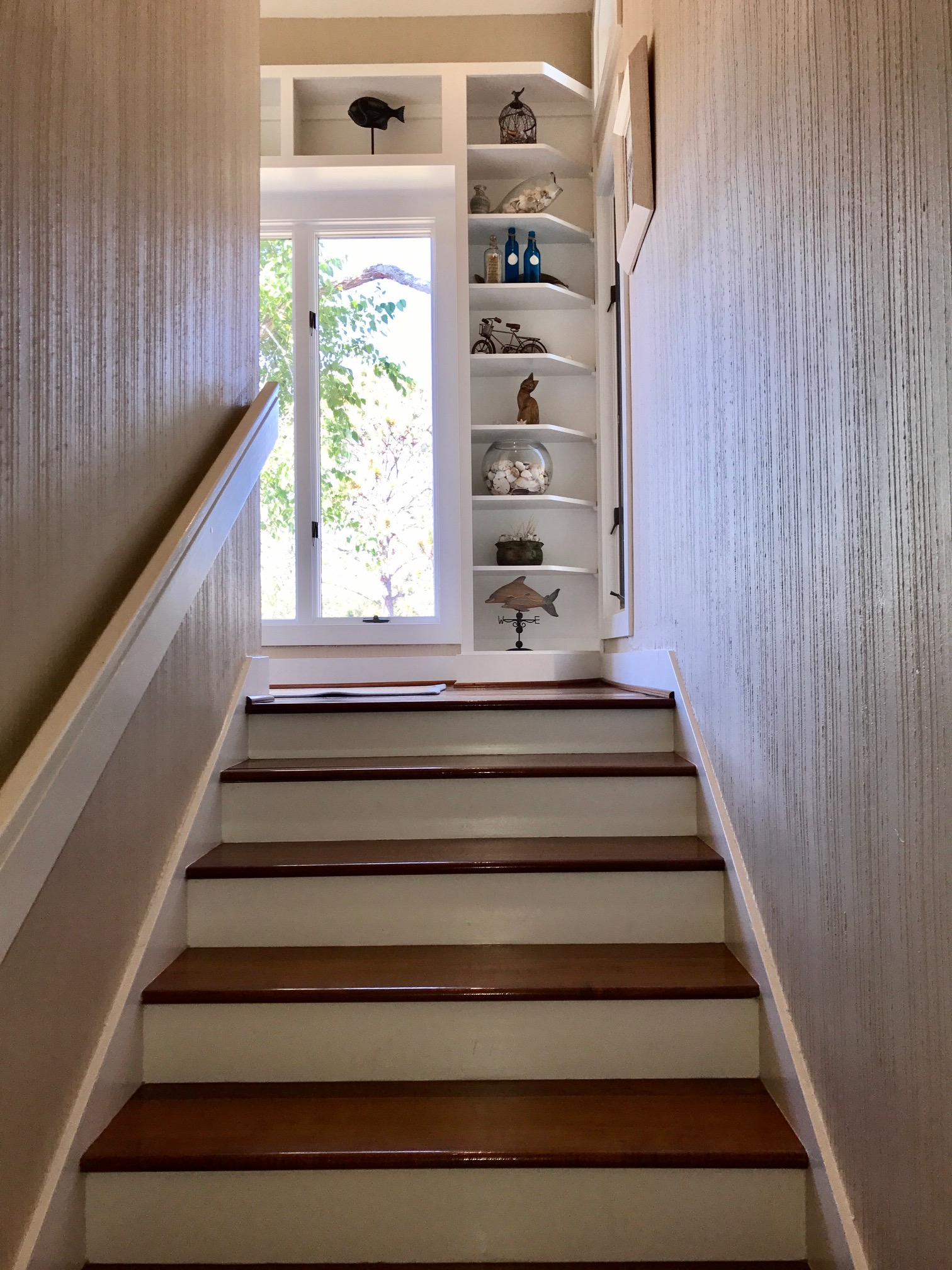This home has a reverse floor plan to take advantage of the views. Take the stairs to the main living area on the second floor.