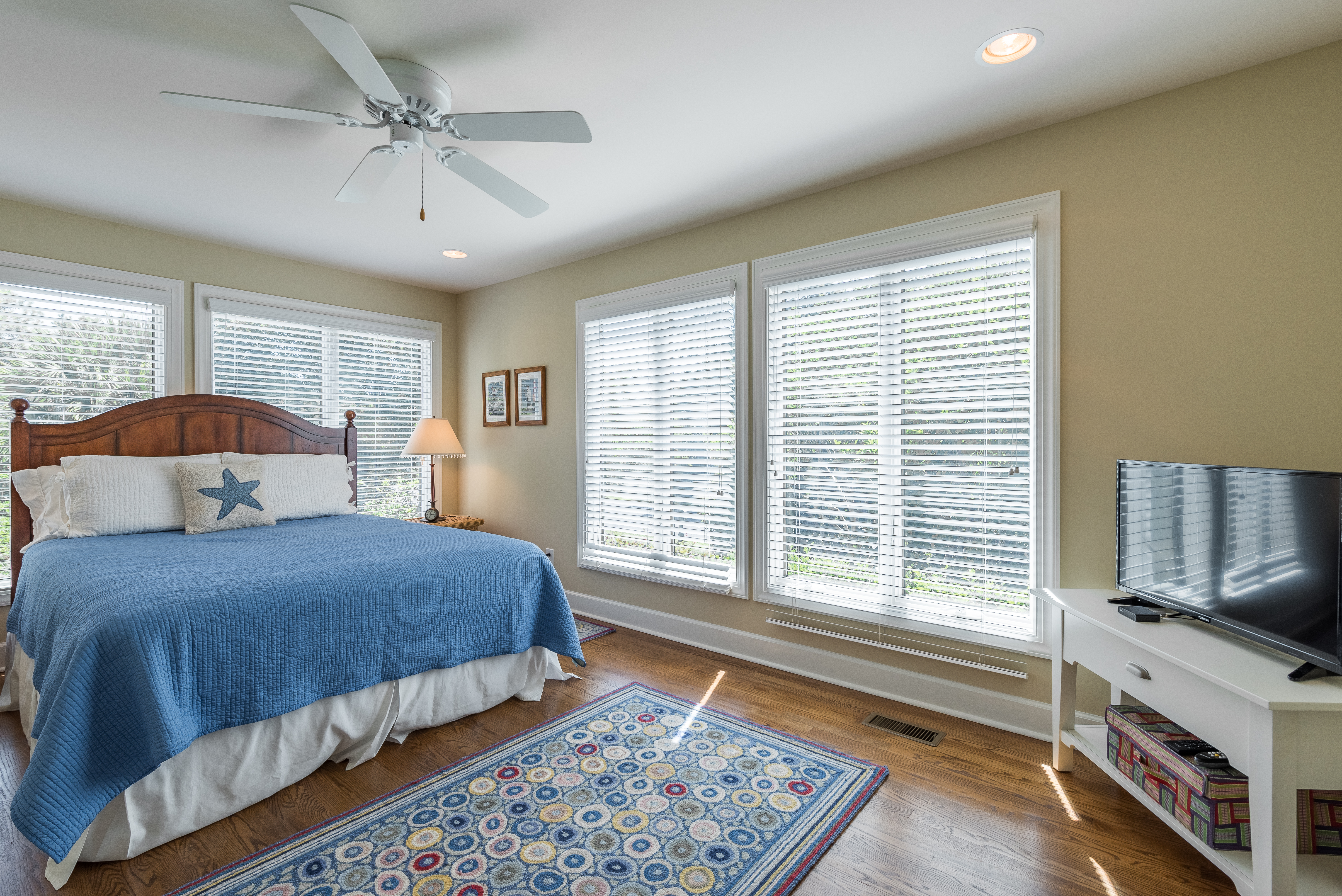 1st bedroom with queen bed and HDTV.  This private retreat is spacious and has a soothing blue and white decor.