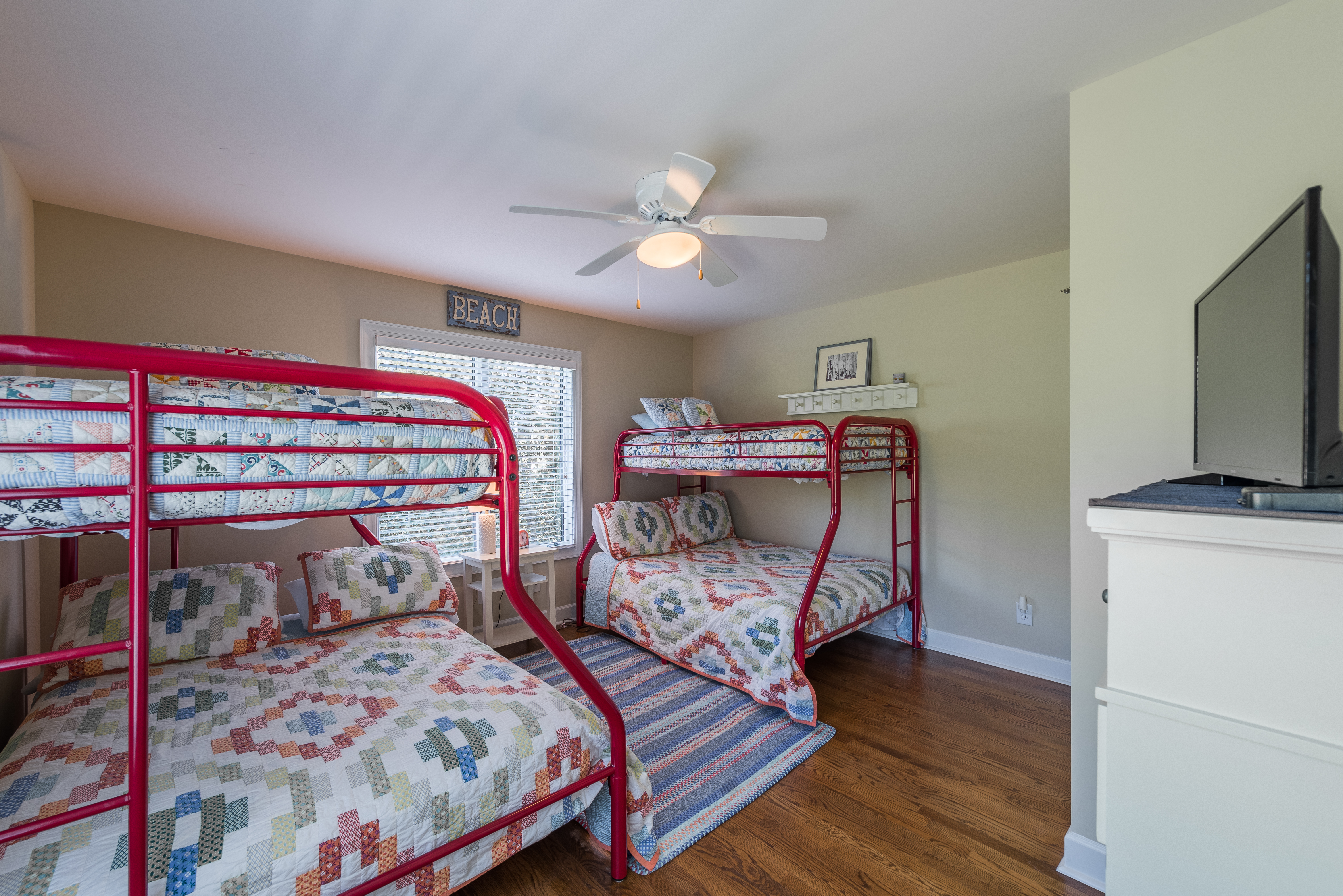 4th bedroom features two sets of bunk beds with a full size bed on the botther, twin over it plus HDTV!