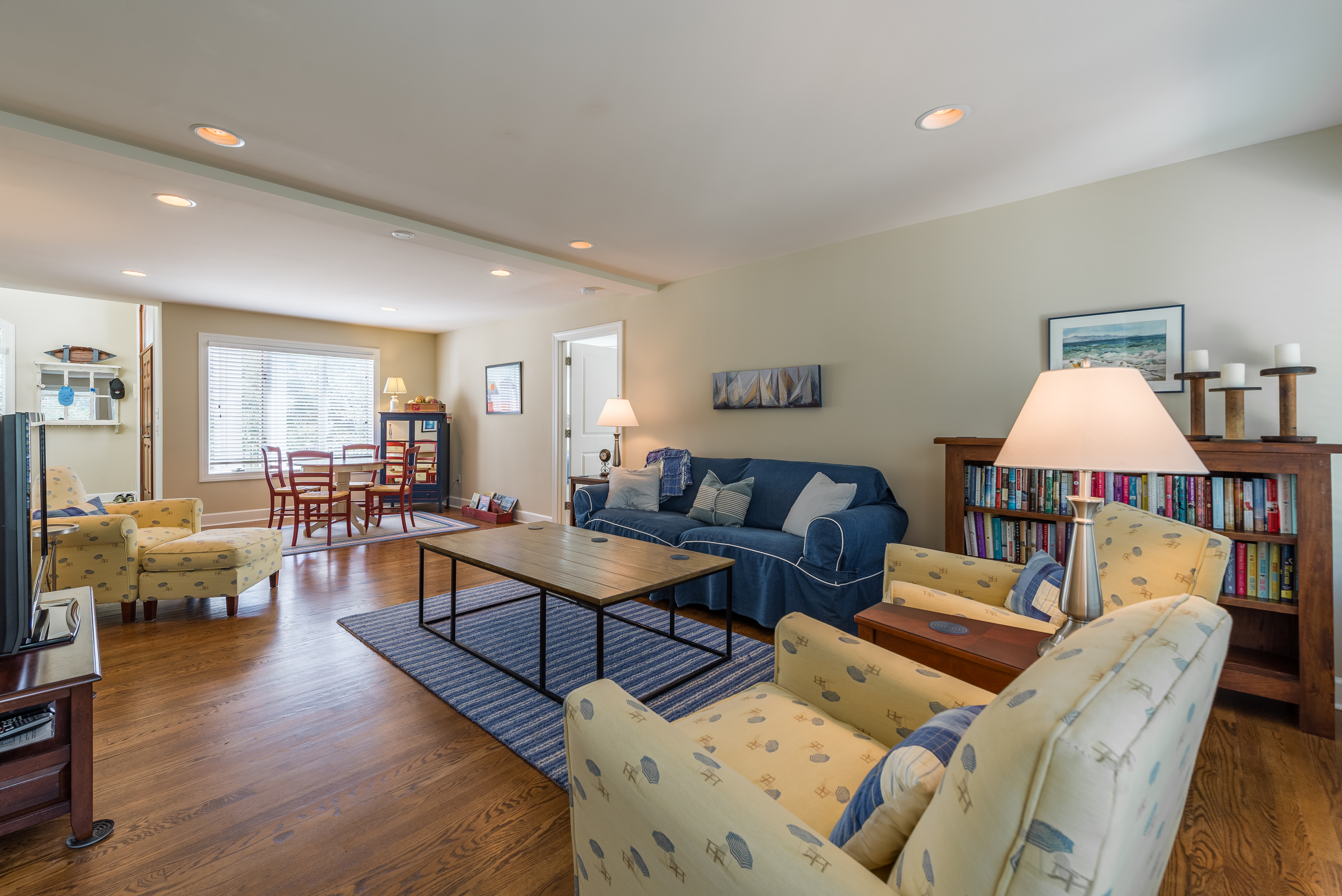 Comfortable family room with HDTV is located on the first floor of this reverse floor plan home.