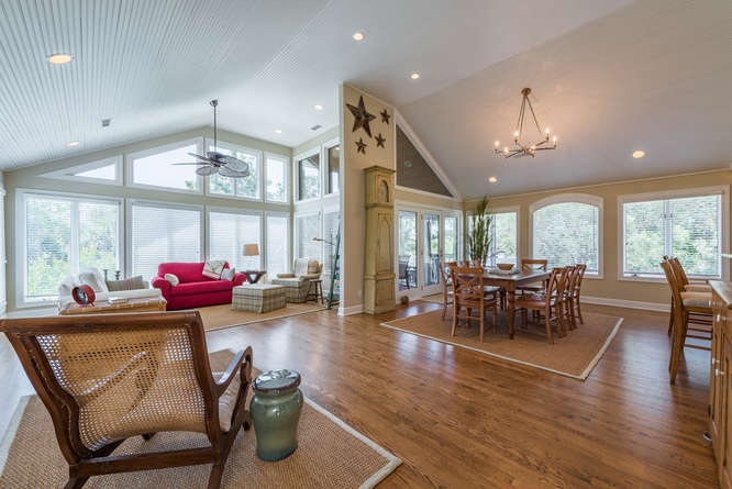Upstairs is a spectacular great room w/ cathedral ceilings & great decor.