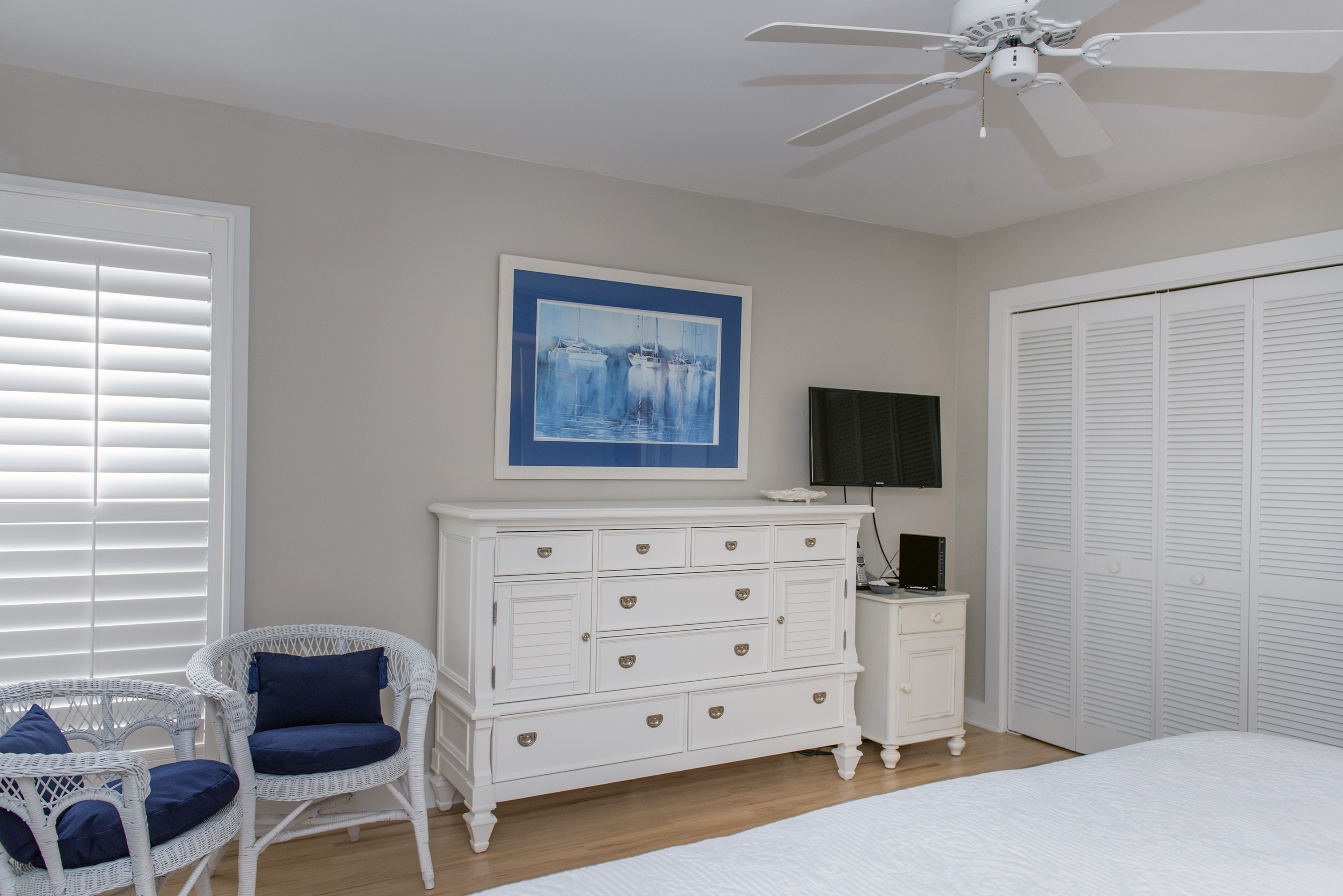 The second bedroom has a mounted flat screen HDTV with ample closet and drawer space.