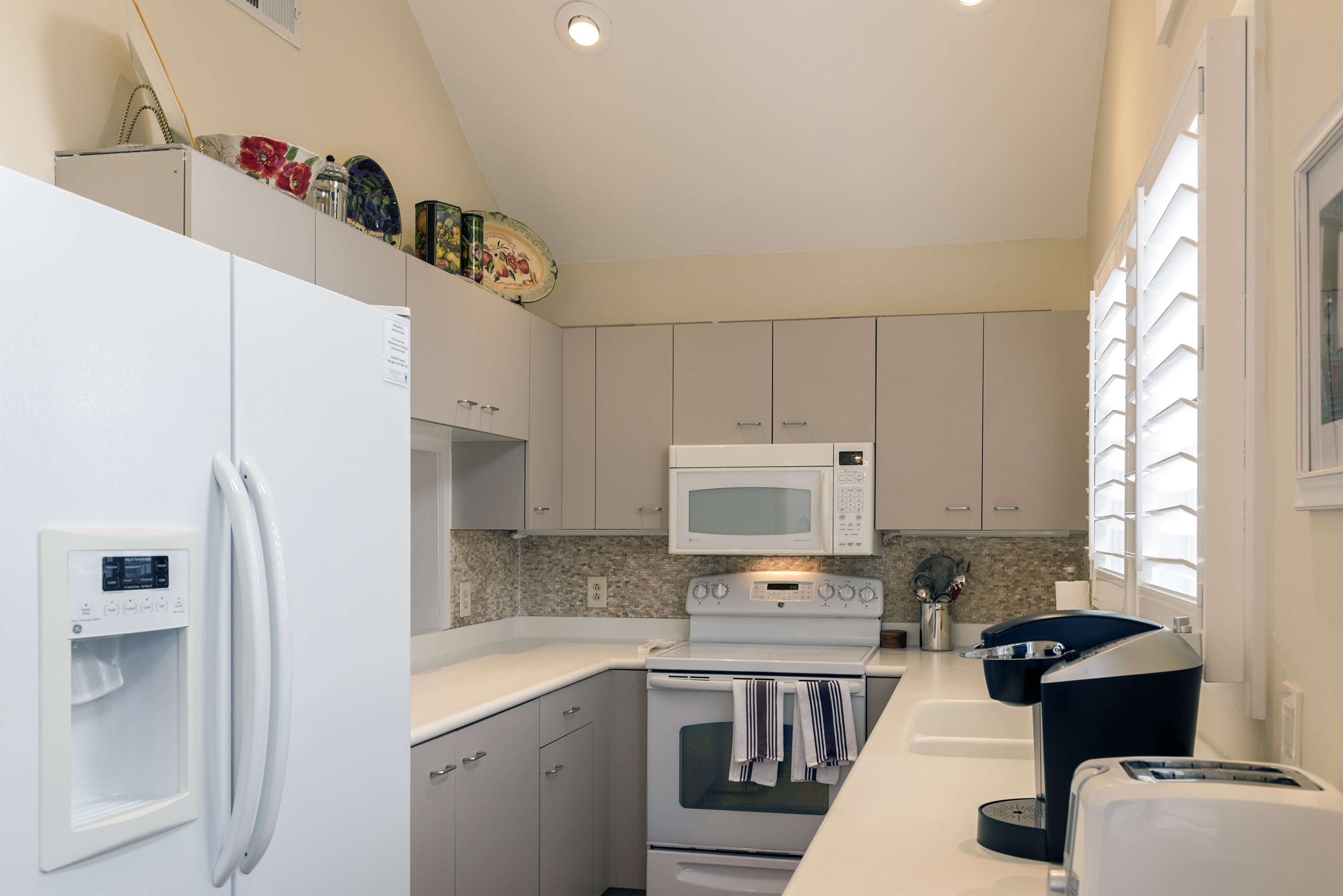 The galley kitchen is well equipped and has Corian counters.