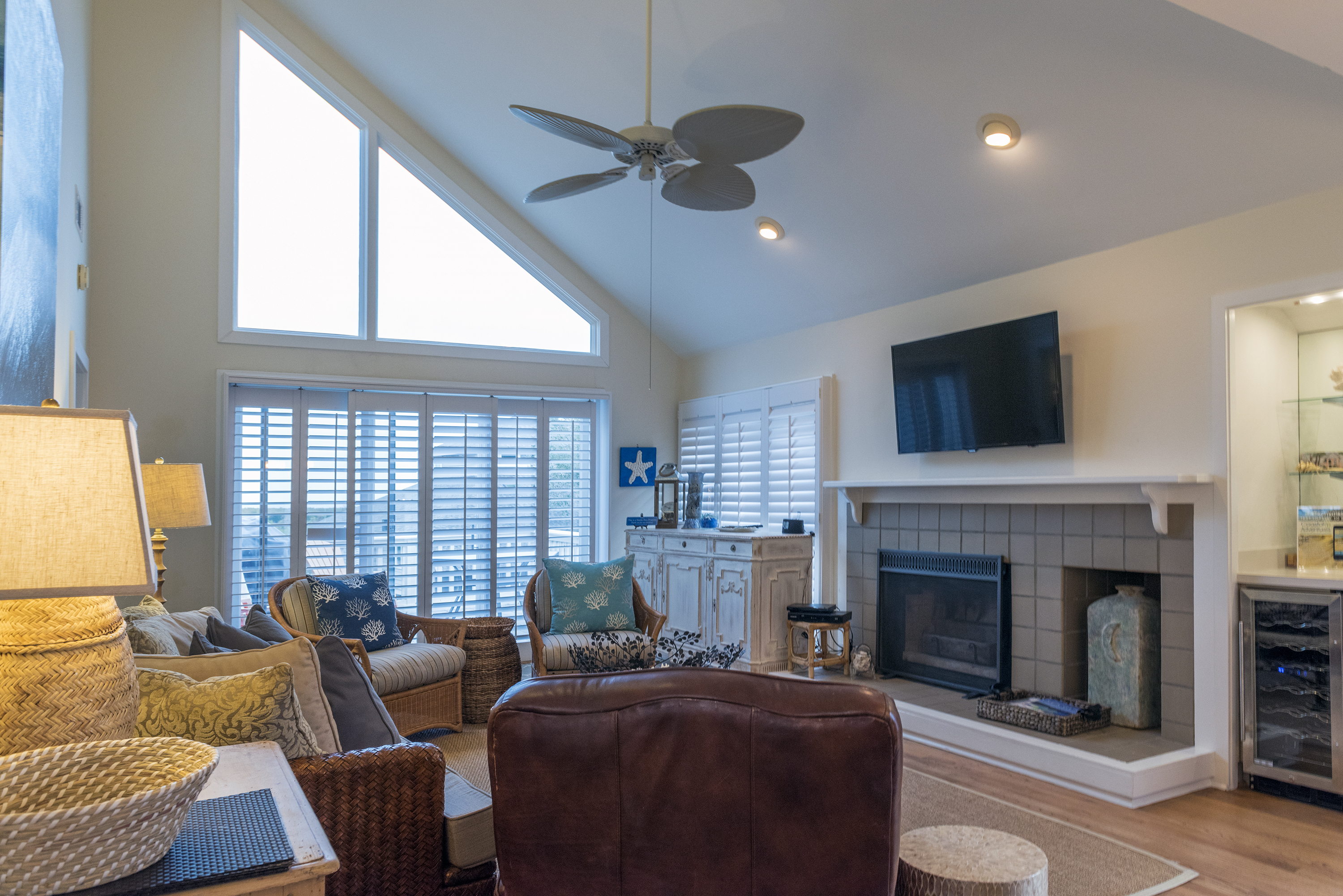 The great room has a fireplace, large HDTV flat screen, wine bar/fridge, and access to the deck with beautiful ocean views!