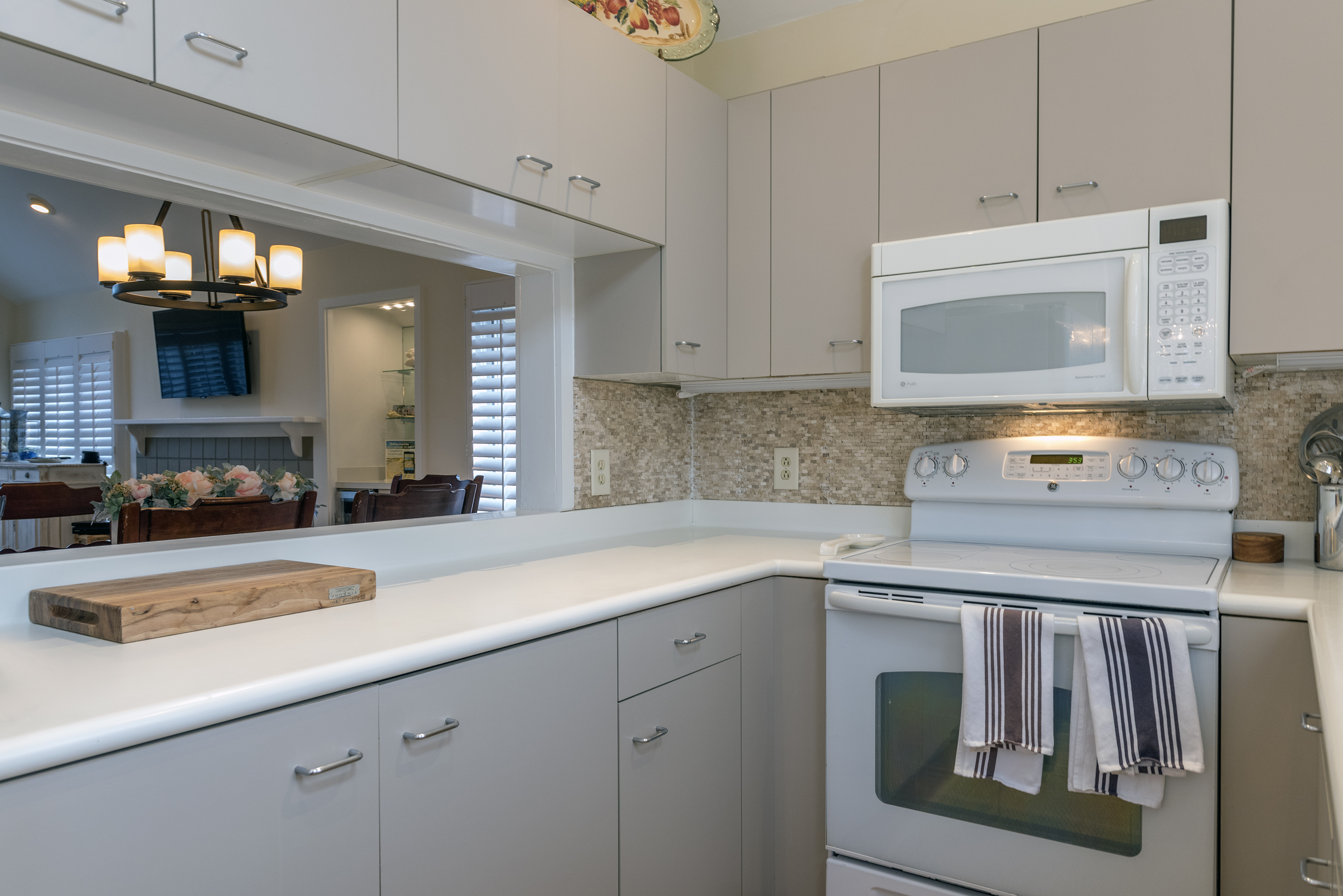 The kitchen has plenty of cupboards and counter space.