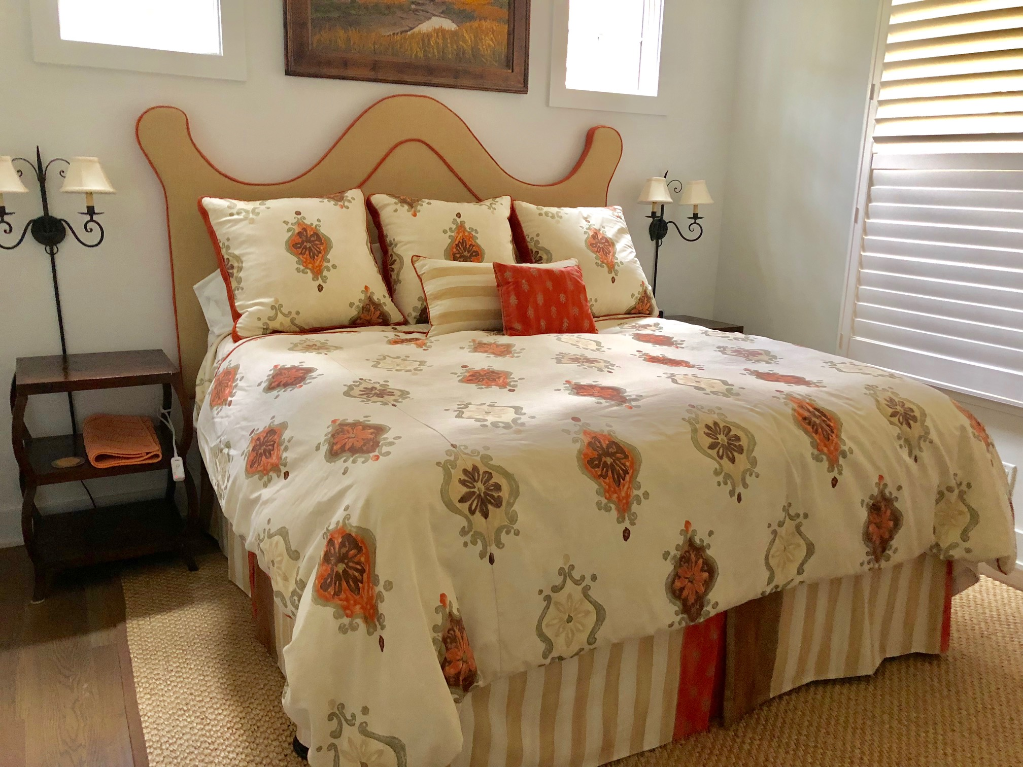 This 1st floor guest bedroom has a king size bed. There is a flat screen TV and large closet.