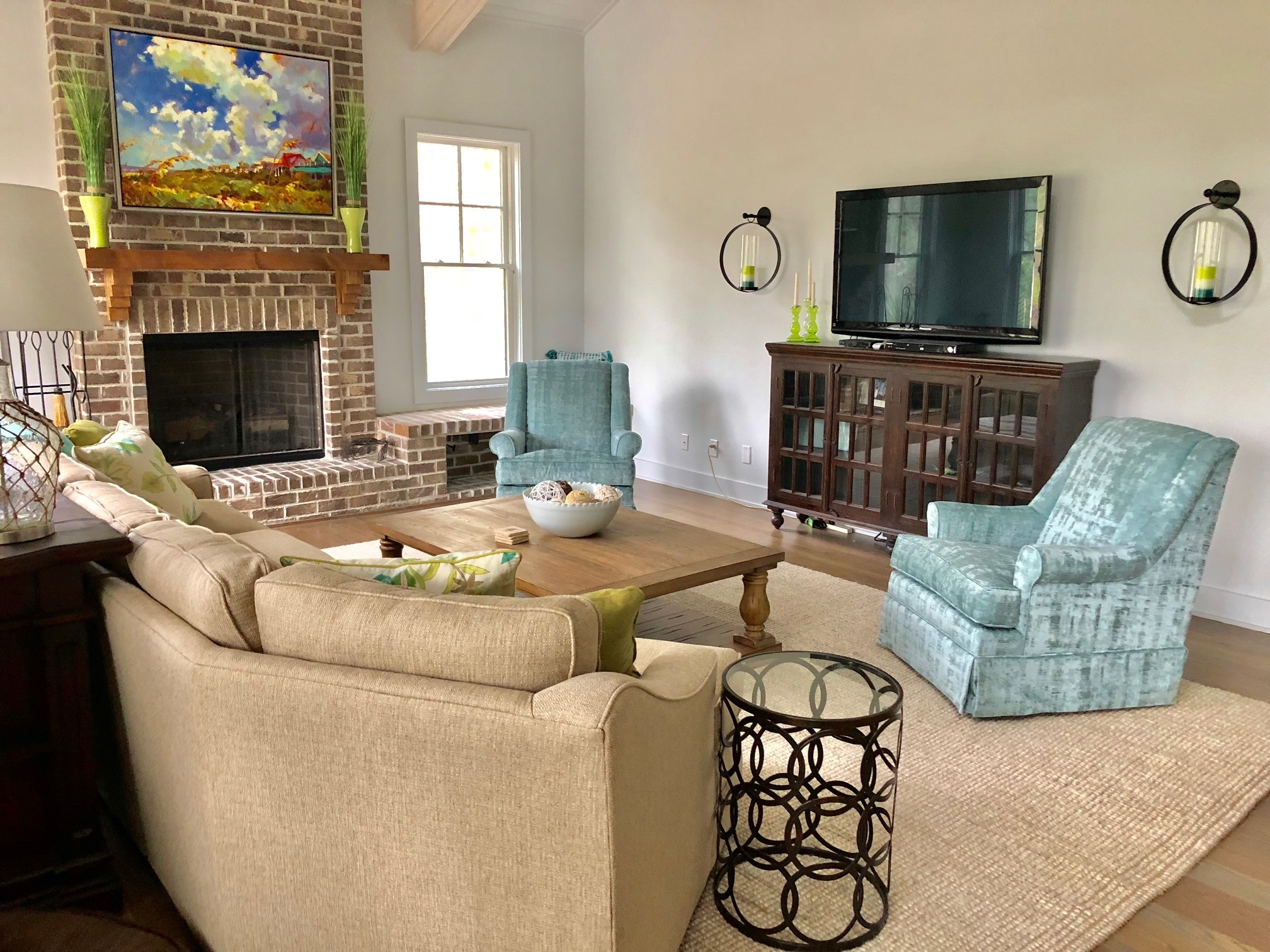 Gather in the great room for entertaining by the beautiful brick fireplace or watch a favorite on the large HD flatscreen.