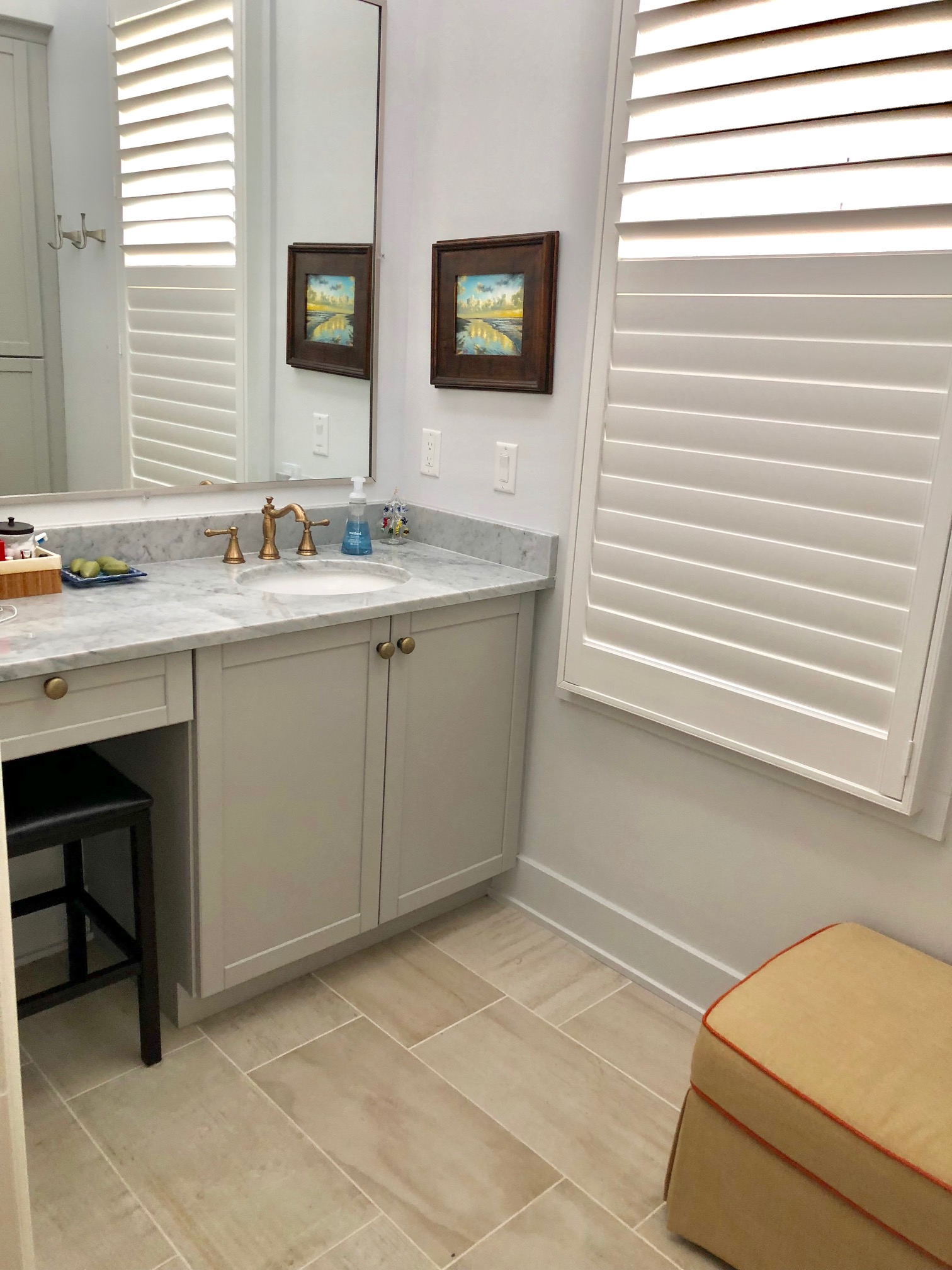The master bathroom has a second sink and vanity area.