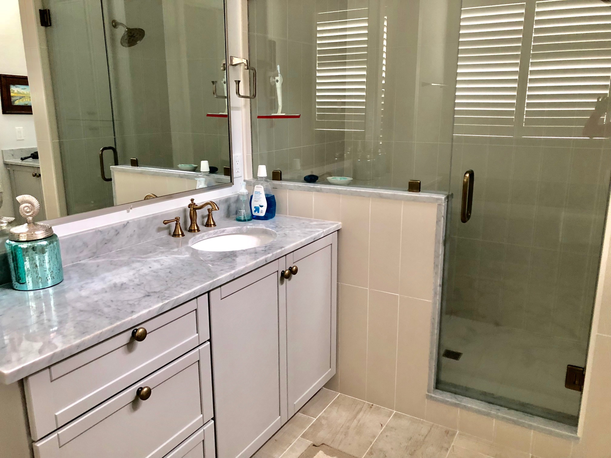 The master en-suite has marble counters, a large walk in shower and two separate sink/vanity areas.